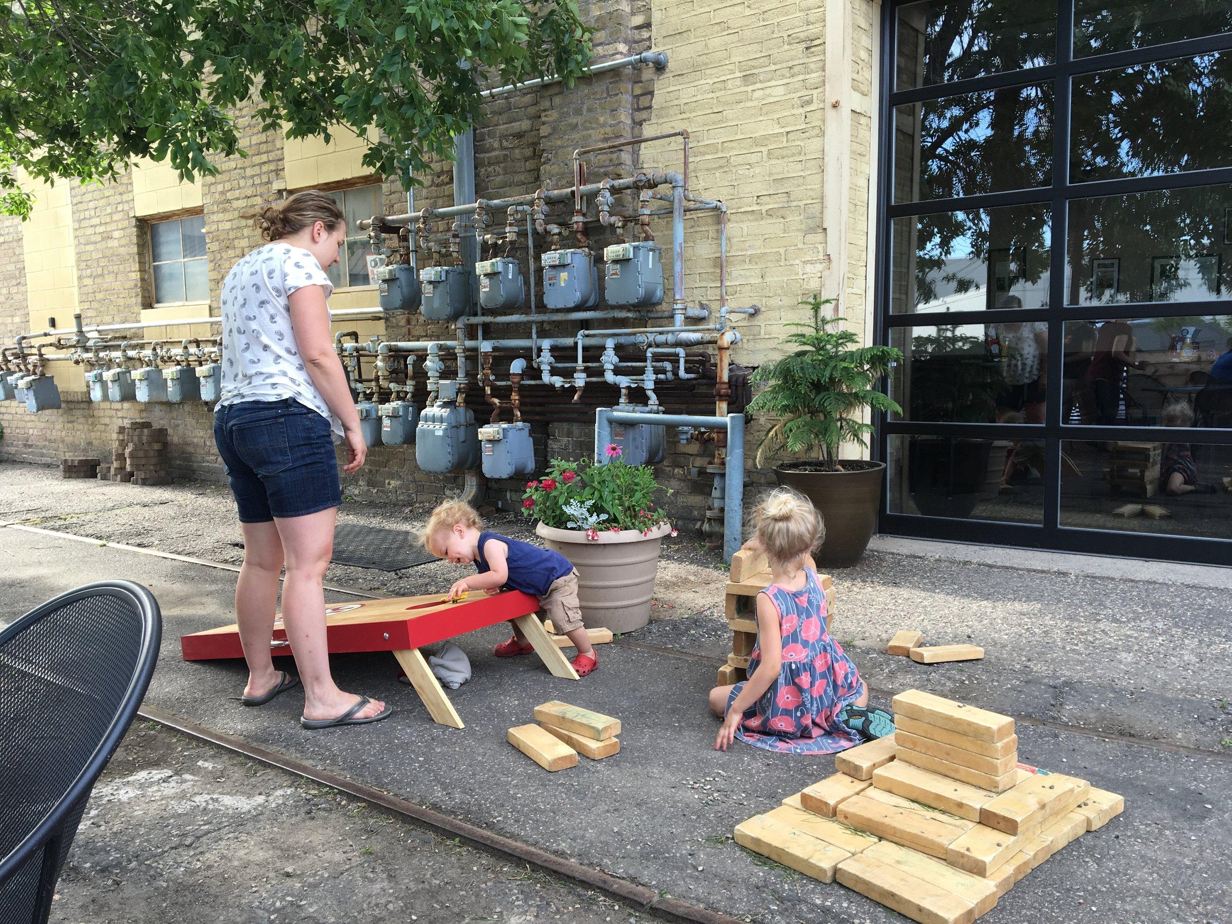 Urban Growler patio with bean bag toss.jpg