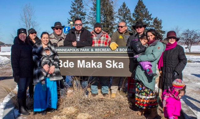 Beane family at Bde Maka Ska sign.jpg