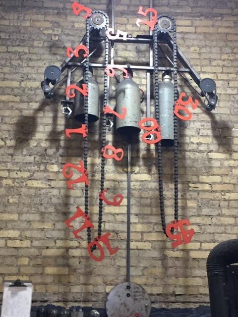 metal clock CAFAC sculpture slide show.jpg