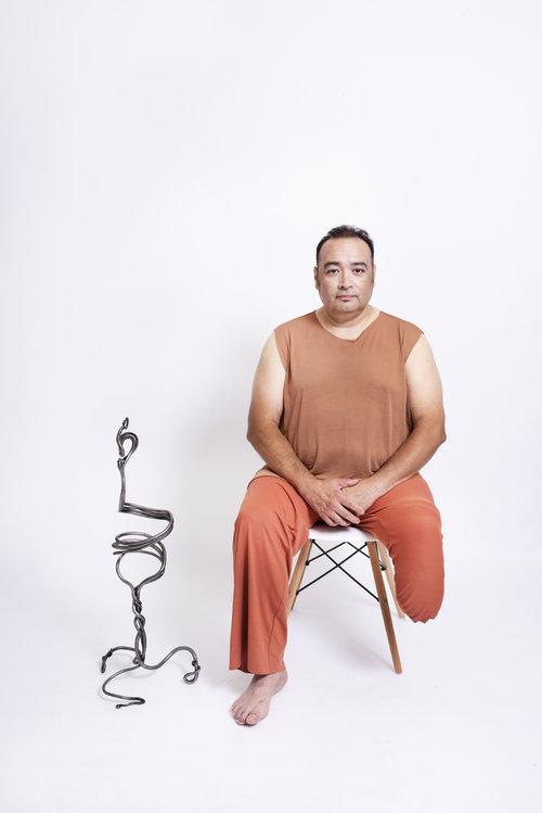 CAFAC man metal prosthetic leg.jpeg