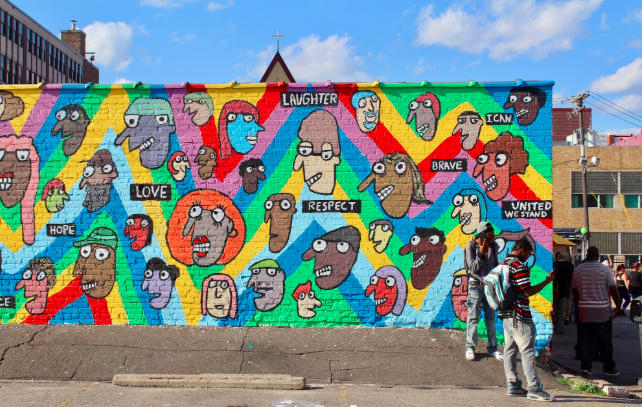 city mural with teens.png