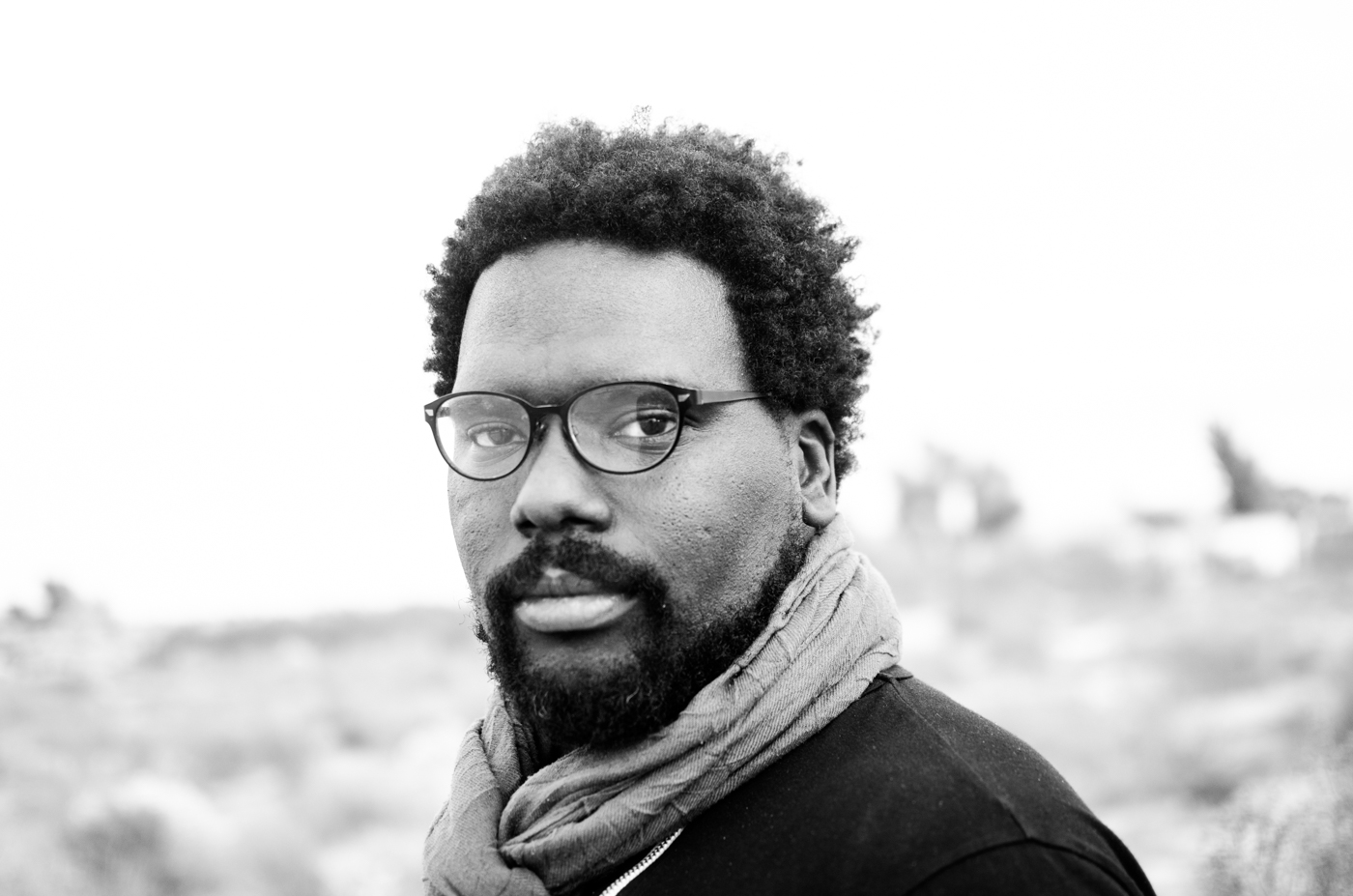 Aaron Johnson - Aaron Johnson is an earth builder, teacher of closeness, and activist. He graduated from the California Institute of the Arts in 2007 with a Bachelor of Fine Arts. He has made a lifelong commitment to use the skills he possesses to end racism. In addition to using intimacy and closeness to blackness as a primary means to that end, the tools he frequently uses are speaking, teaching, singing, photography, filmmaking, and minimalism. Aaron leads a mentoring program called Turn It Up Now that focuses on elevating the power, talent, love, and work ethic of youth. He believes that deep connection is one of the most powerful tools one can use in dismantling racism.