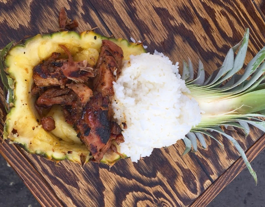 Pineapple Teriyaki Bowl - -My Favorite-A sliced open half of a pineapple serves as a bowl to this sweet and savory combo. Filled with grilled pineapple, chicken teriyaki, and topped with rice, this is the 'fair food' that I look forward to each year! The bowl can also be ordered with shrimp or just veggies!