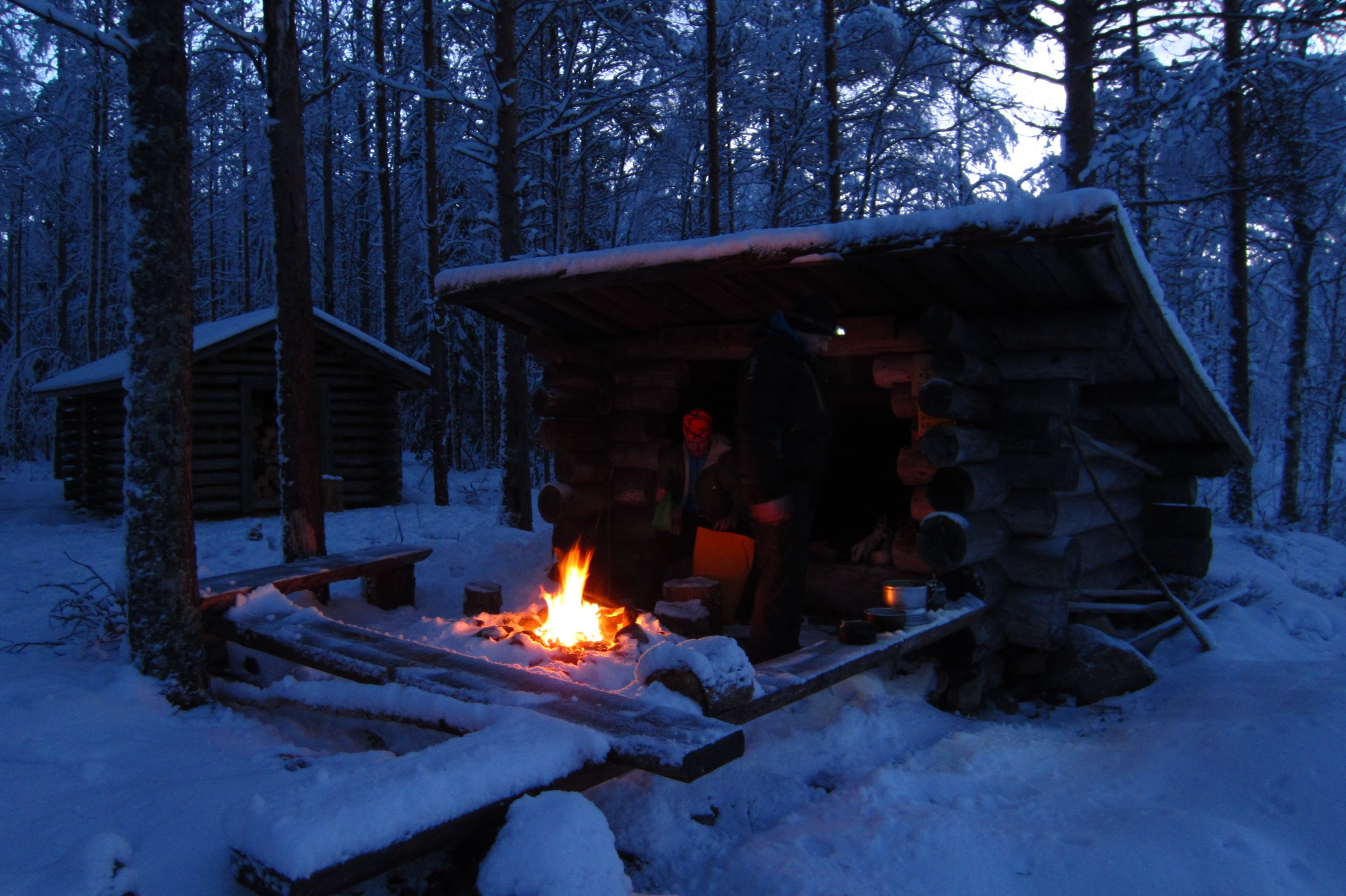 guided winter hiking snow and campfire Finnish nature