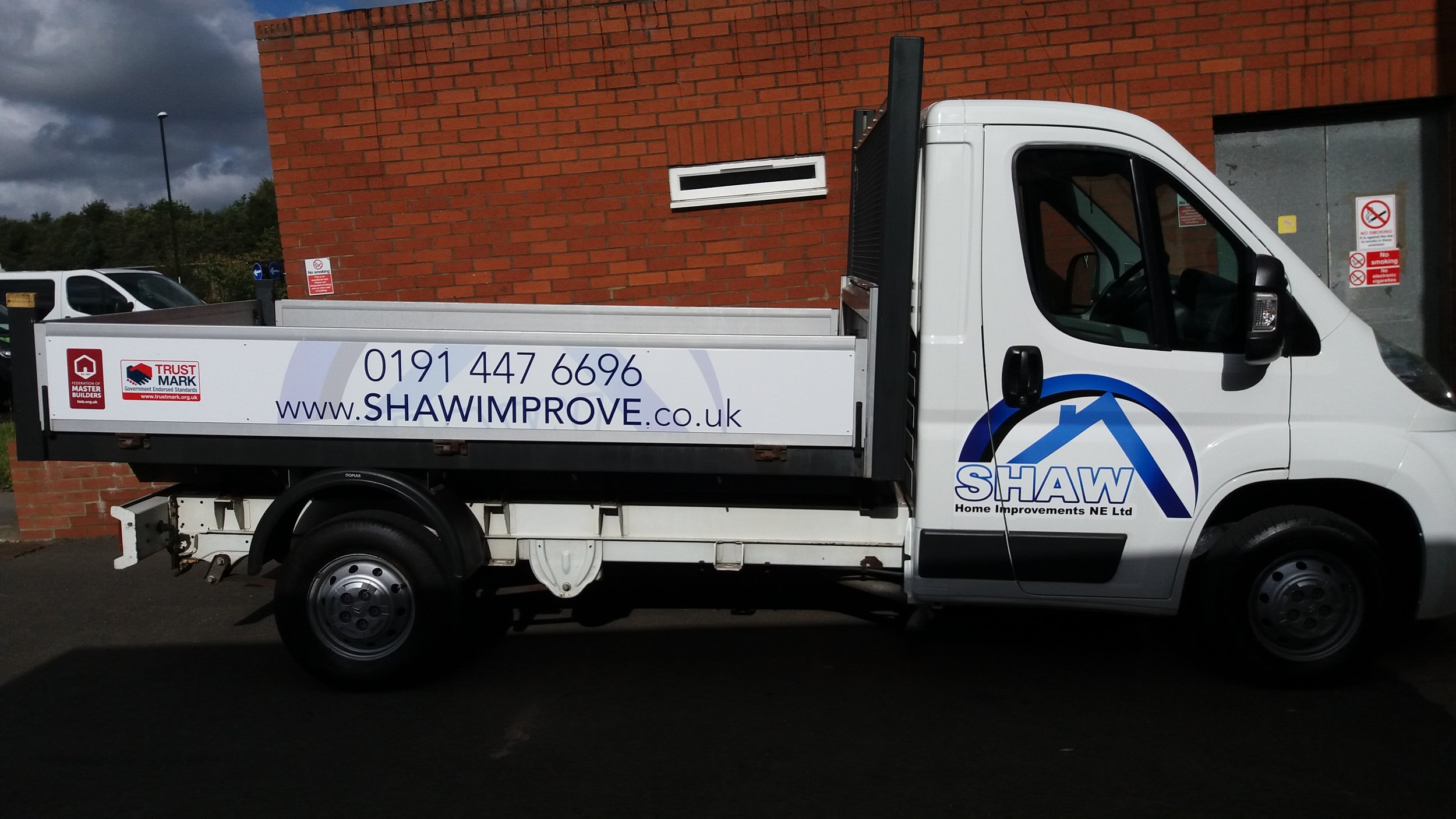 SHAW HOME IMPROVEMENTS   Shaw Home Improvements were in need of vehicle graphics to be applied to their Citroen Flatbed van. We advised large scale digital prints to fit along both sides, and the rear, along with logos for both cab doors and the bonnet.