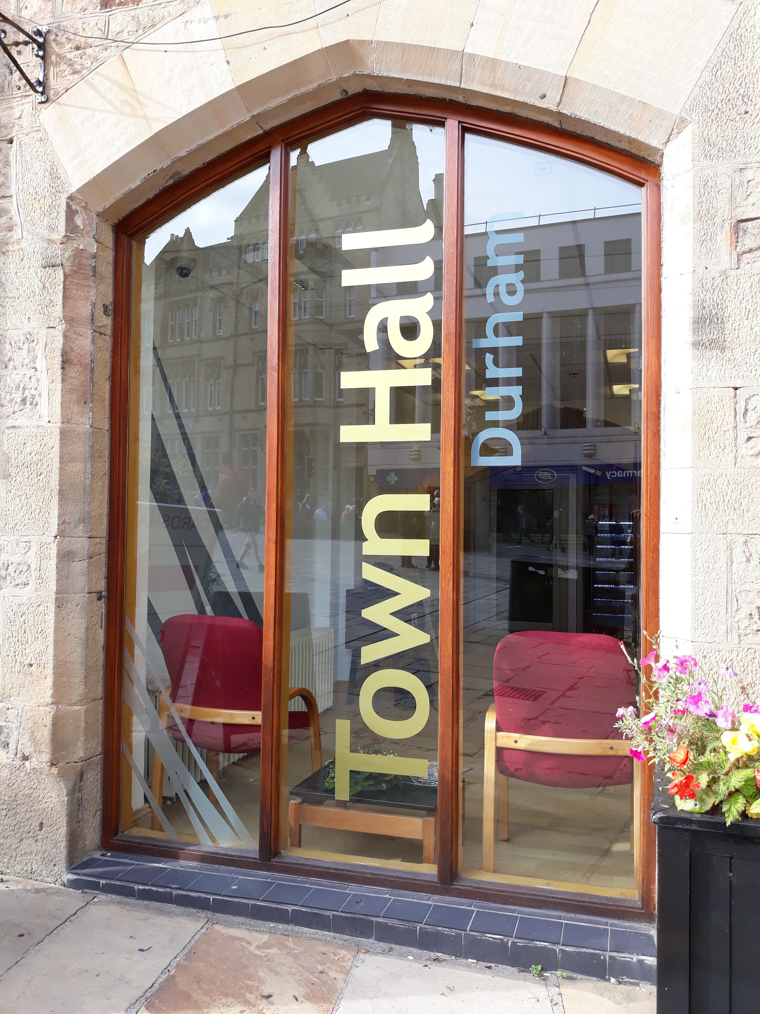 DURHAM TOWN HALL   Gold and silver vinyl lettering.