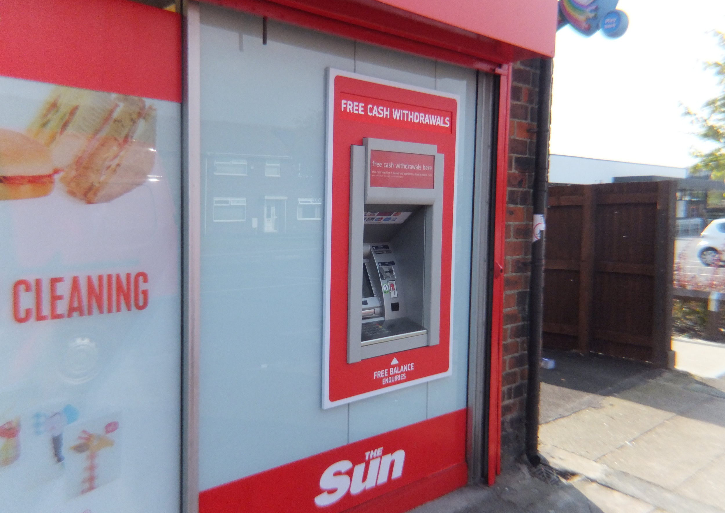 KWIK SAVE   Window graphics fitted externally to fit around a cash point.