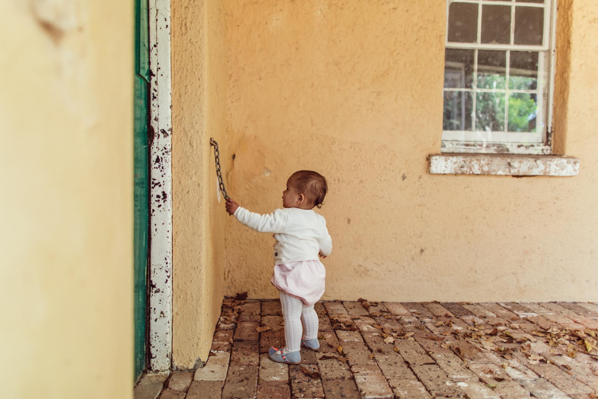 sydney documentary photographer - baby playing outside