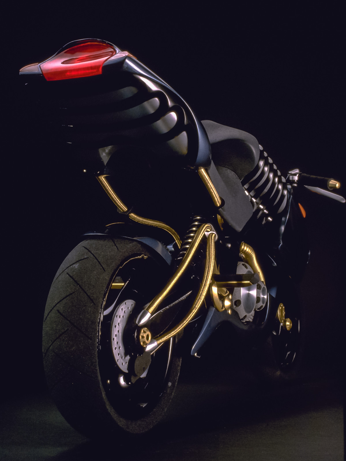 Frog perspective rear view of the final finished scale model of the metallic blue and gold accented H2 motorcycle