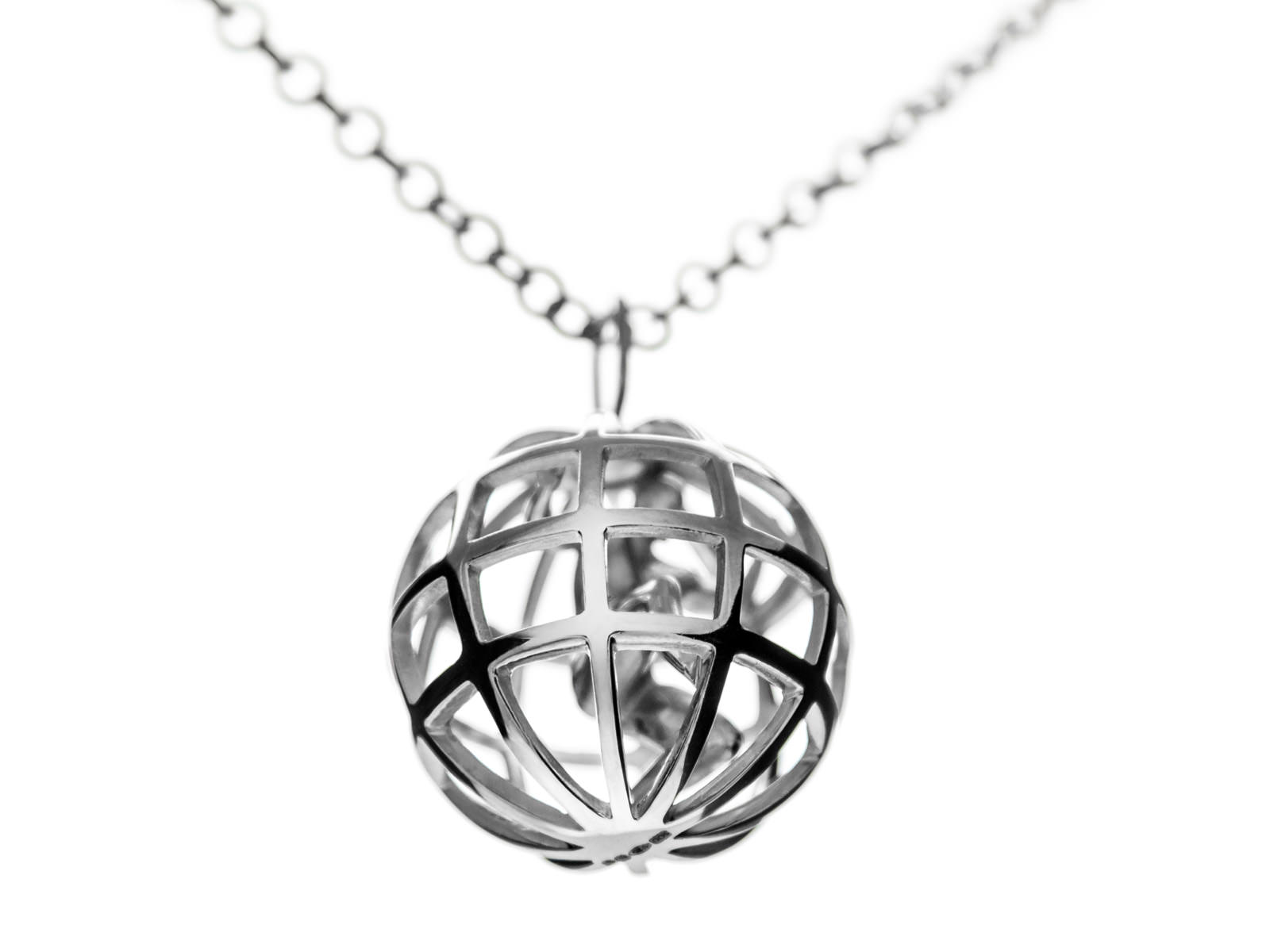 A stirling silver Atlas pending hanging from the silver chain