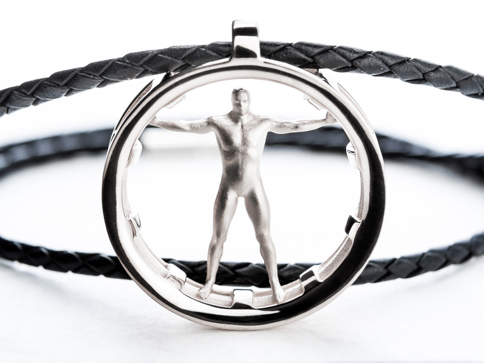 The Vitruvian Man pendant with a Vitruvius-inspired main standing in a ring of silver