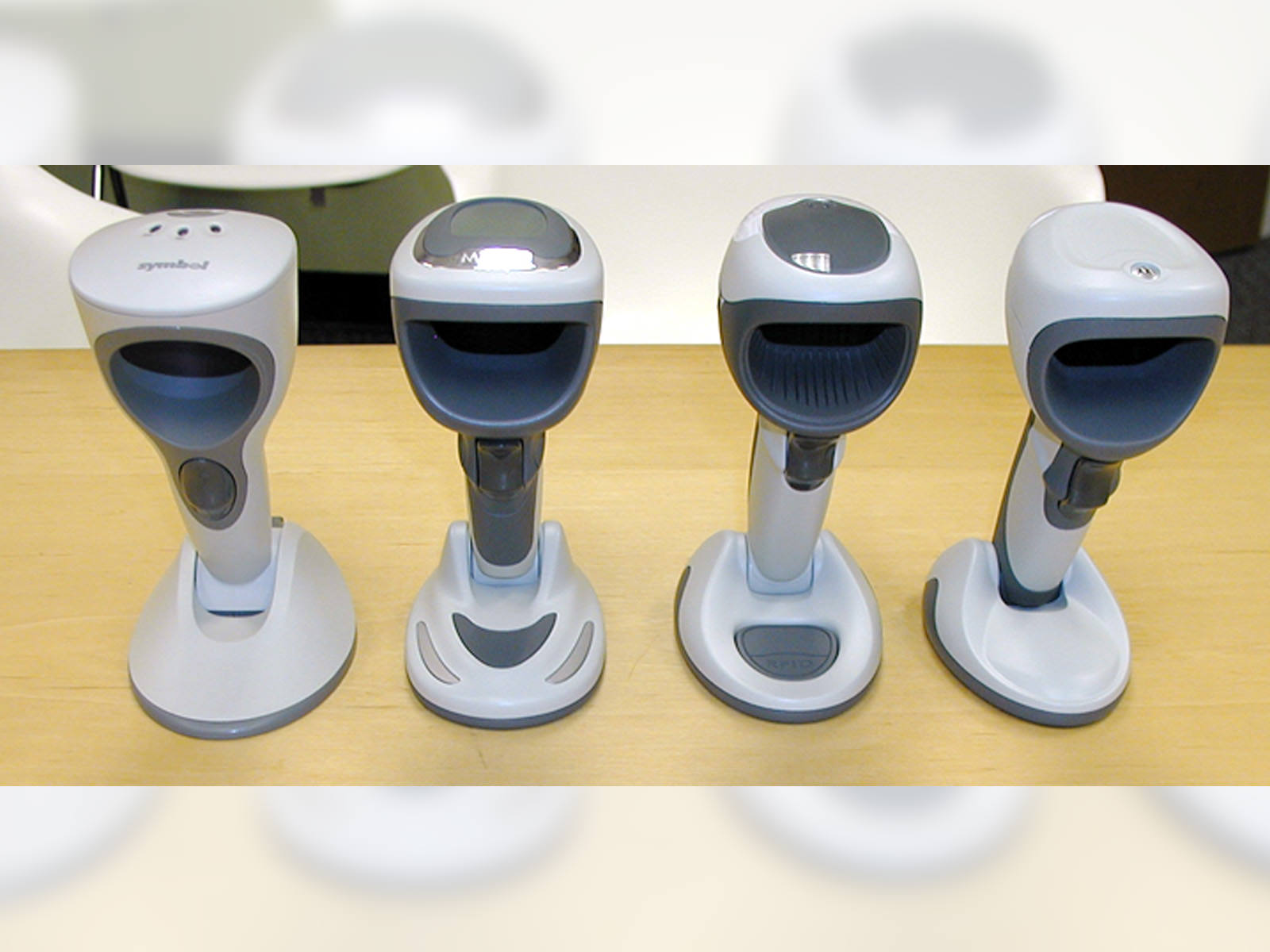 Physical appearance models of the 3 DS9808 concepts next to the previous generation scanner