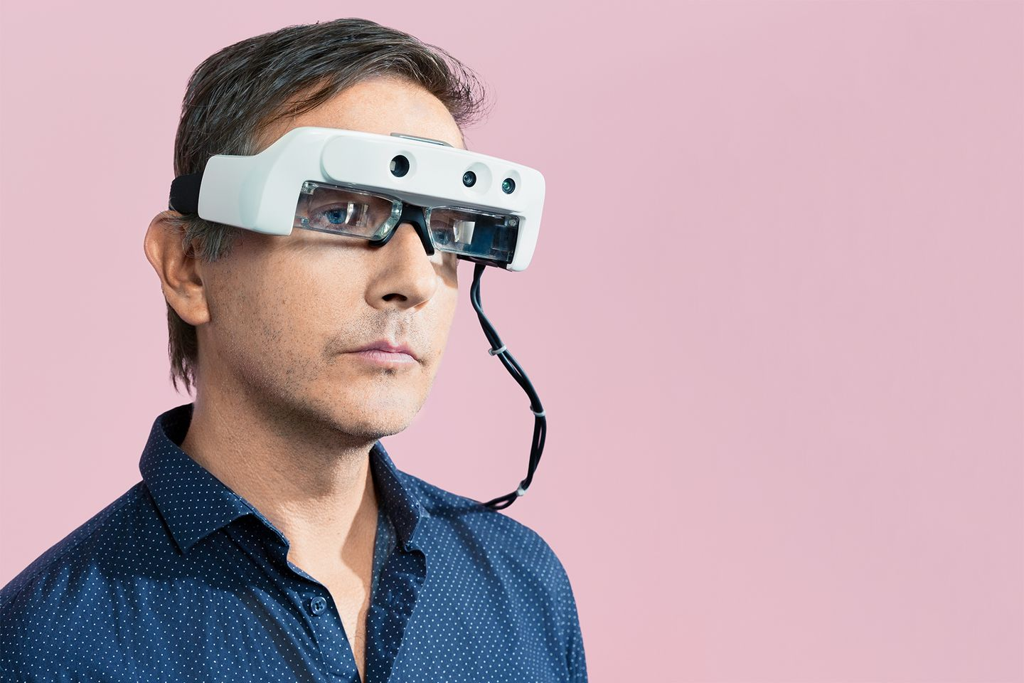 Dr. Stephen Hicks wearing the white Helios headset - Image courtesy of Wired Magazine (Credit: David Vintiner)