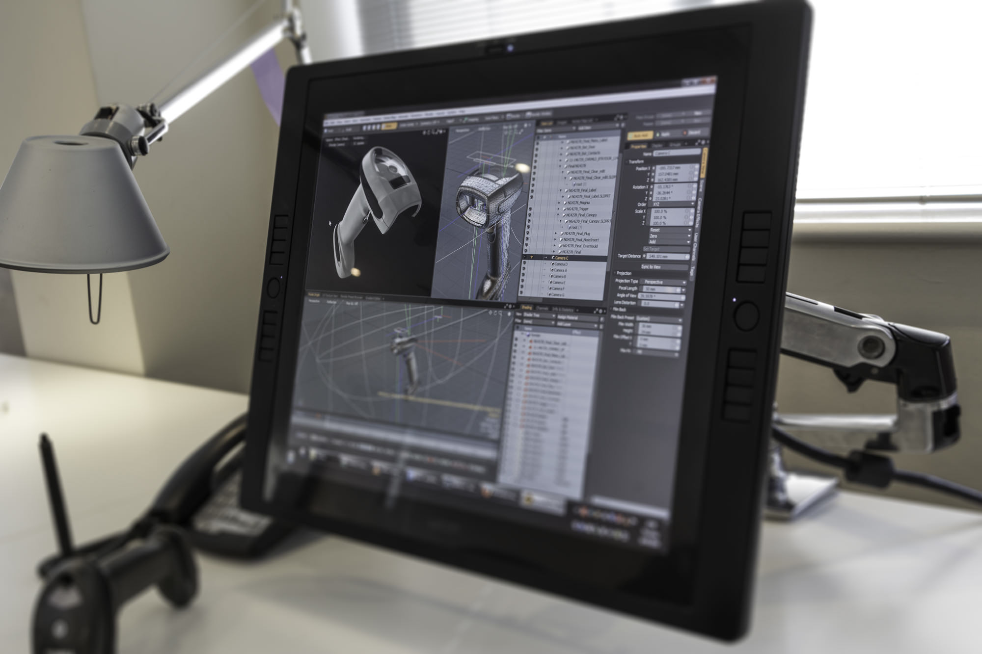 A Wacom Cintiq monitor at Thinkable Studio displaying a preview of a 3D rendered scene in Modo software
