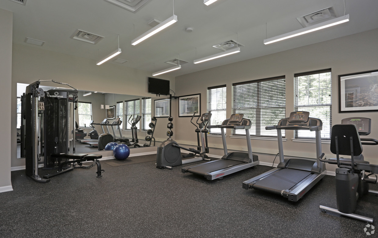 Fitness room with lots of equipment and tv to watch while working out