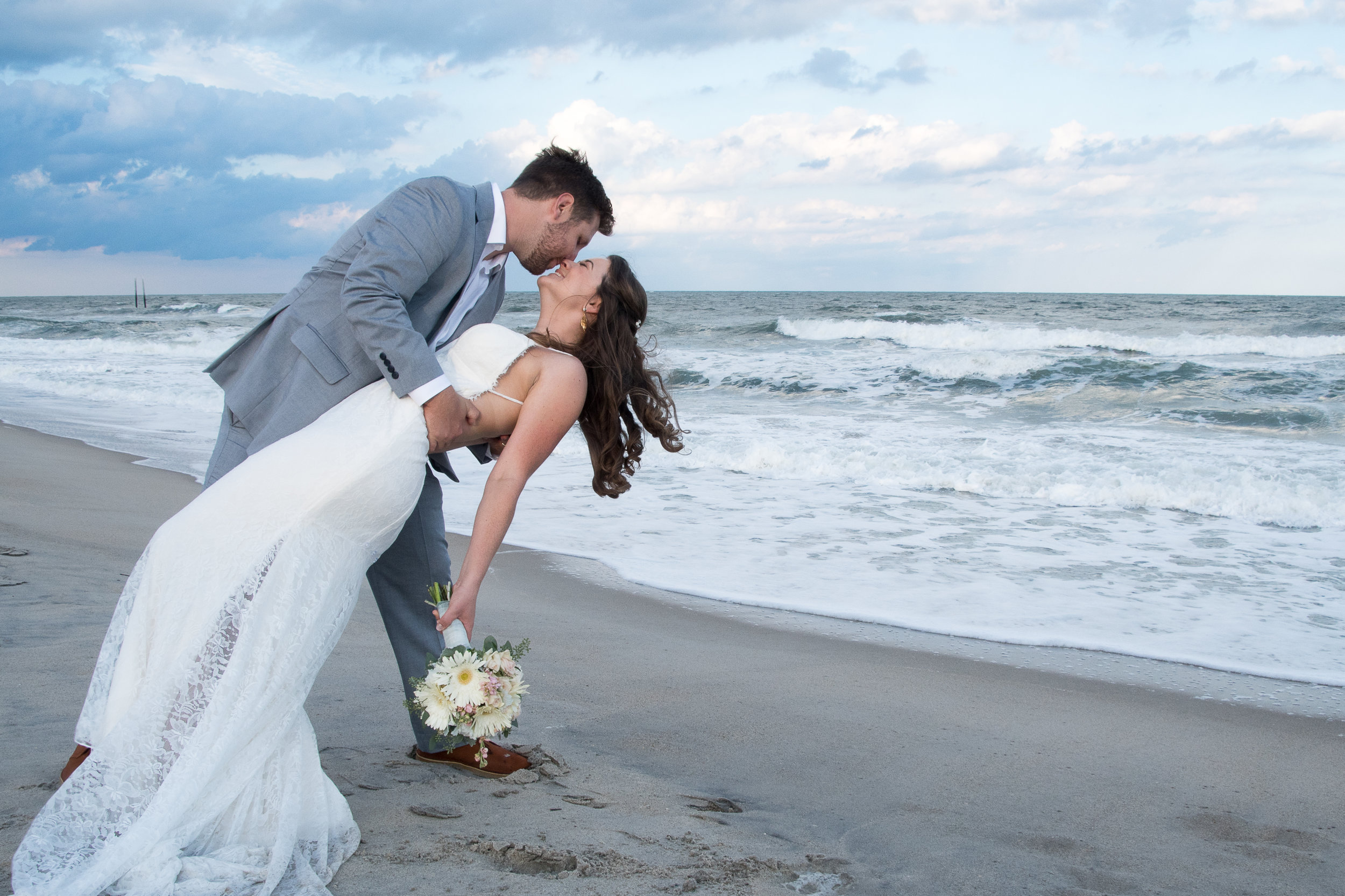 - A classic pose, the Groom dipping his new Bride on the beach after the wedding ceremony.
