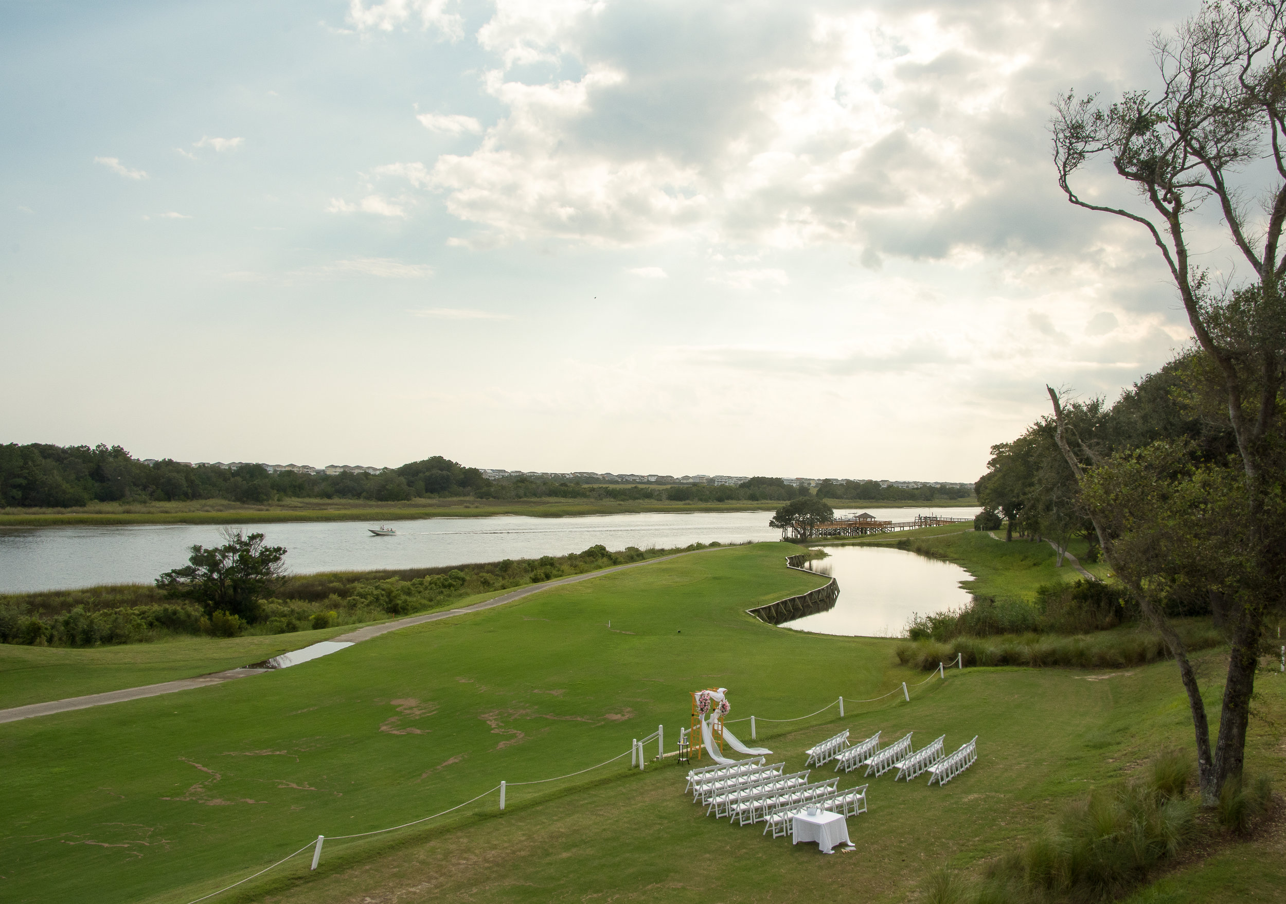 - Beautiful fairway wedding ceremony set up overlooking intracoastal waterway.