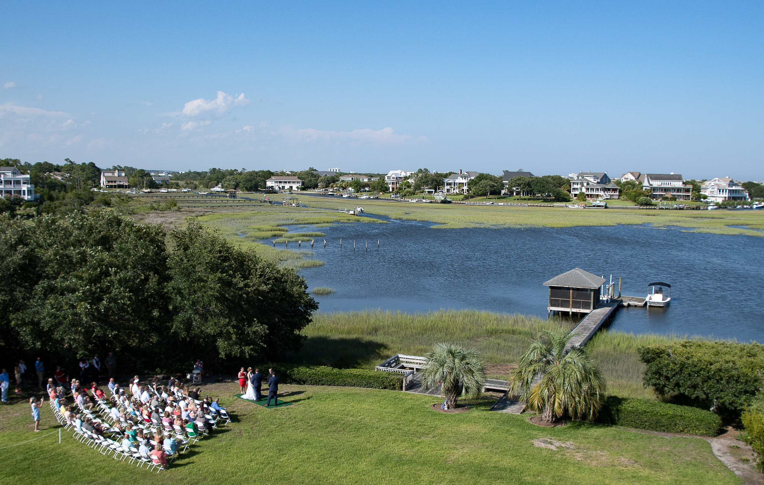 - Beautiful view of ceremony from rooftop of intracoastal waterway residence.