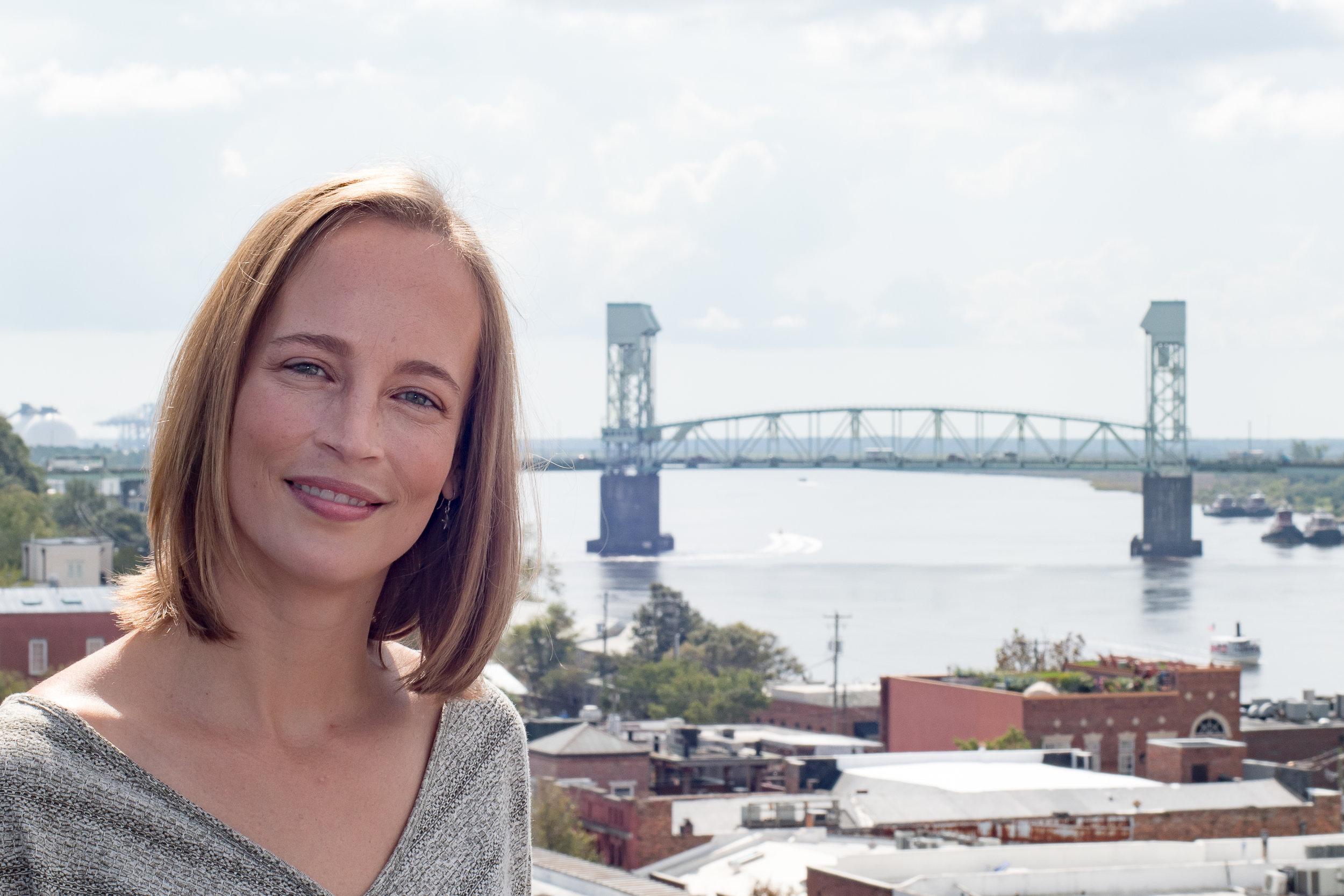 - Headshot overlooking Cape Fear Memorial Bridge in Downtown Wilmington, NC.