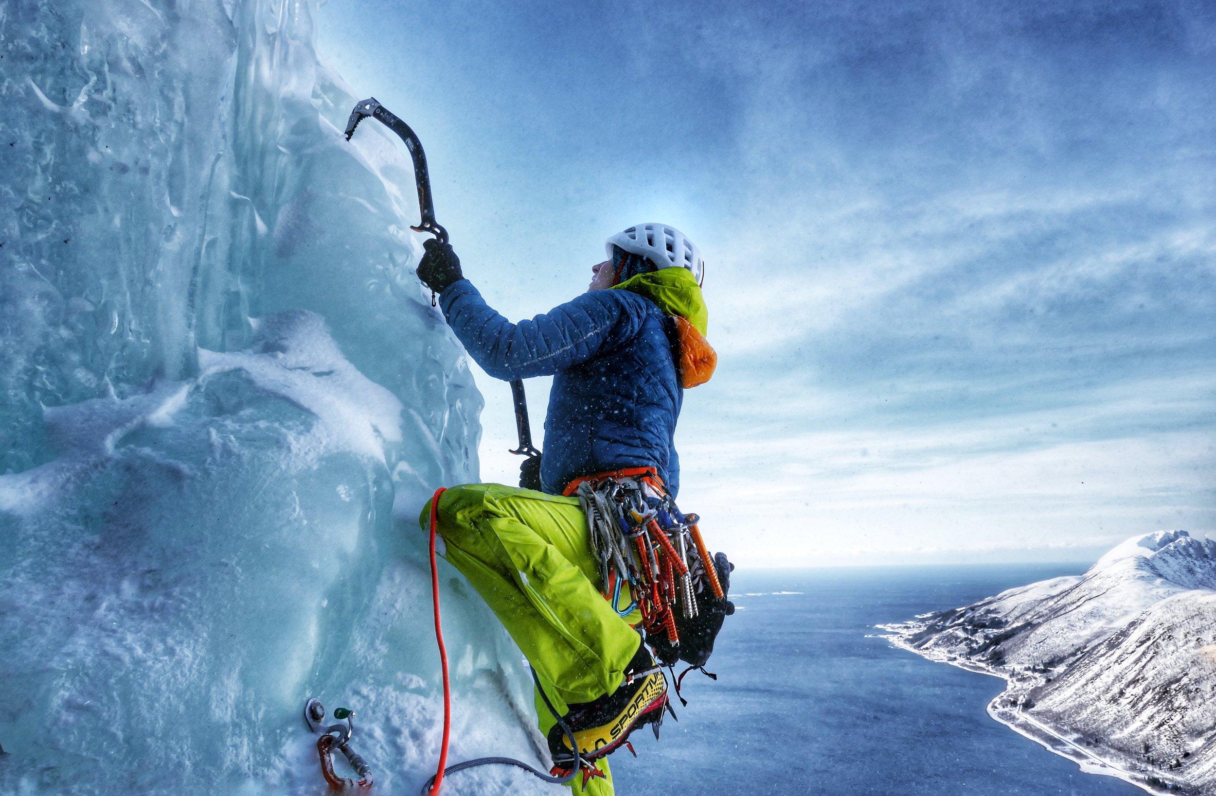 Tanja Schmitt high above the sea during the ascent of 'Finnkona' on Senja Island - picture Matthias Scherer