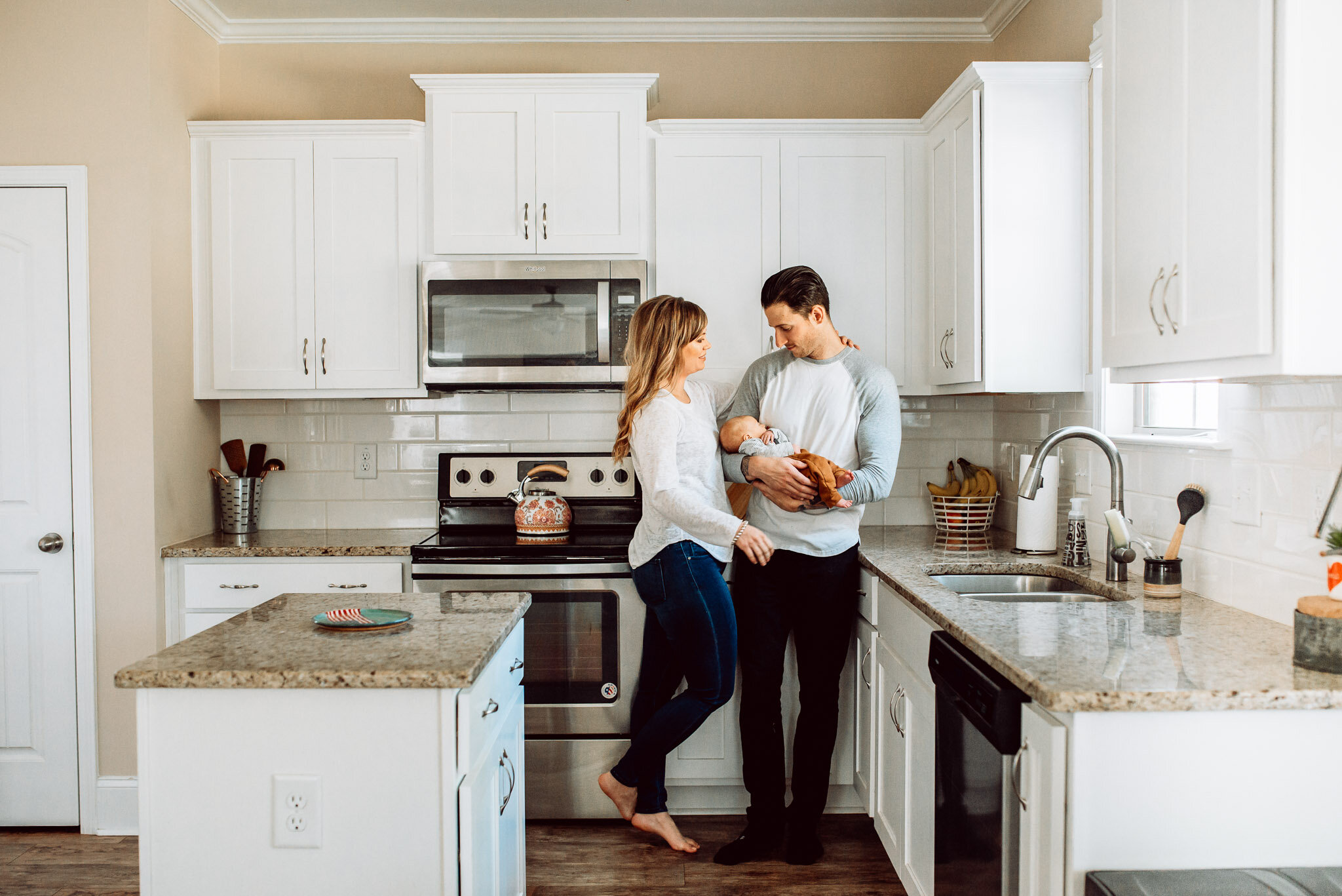 Family in kitchen white cabinets
