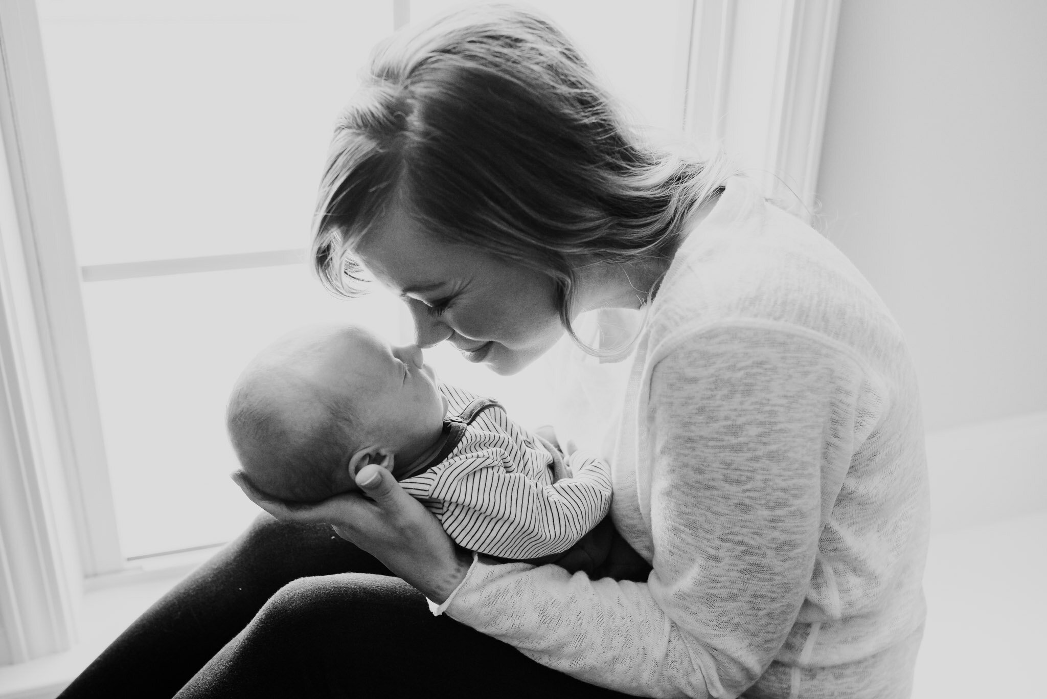 woman and baby touching noses
