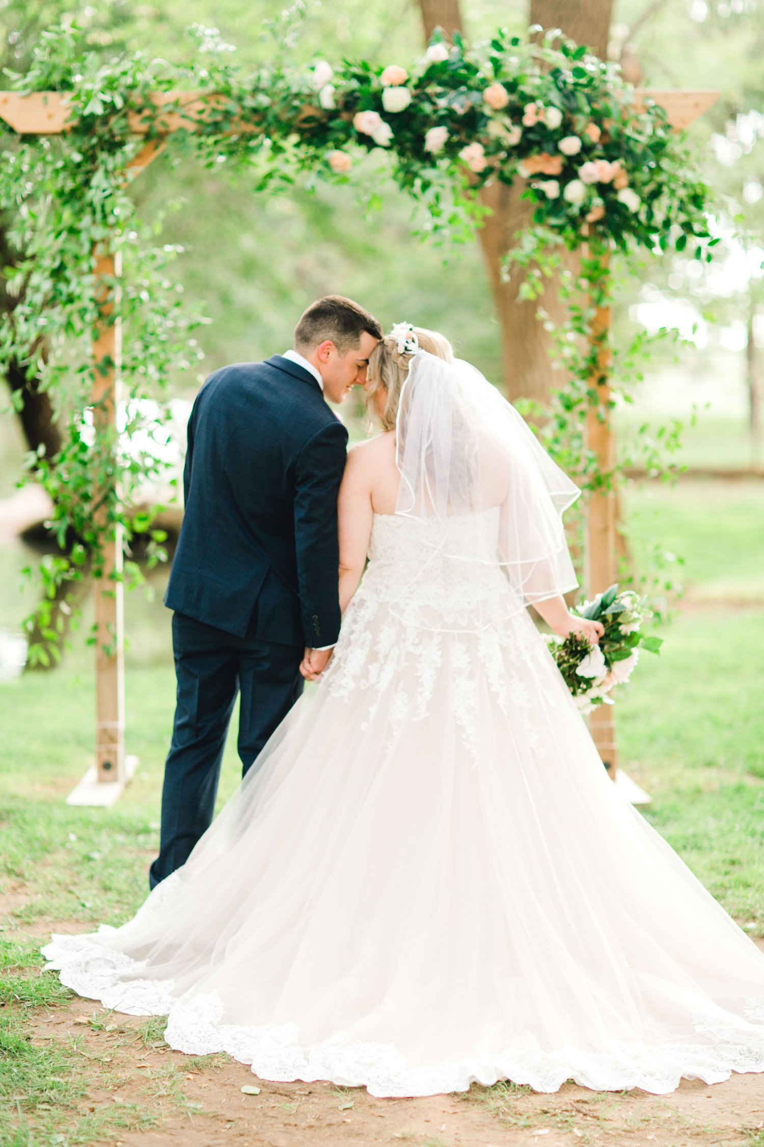 SARAH_AND_GEOFFREY_SHARP_SPIRIT_RANCH_WEDDING_ALLEEJ_LUBBOCK_TX_0097.jpg