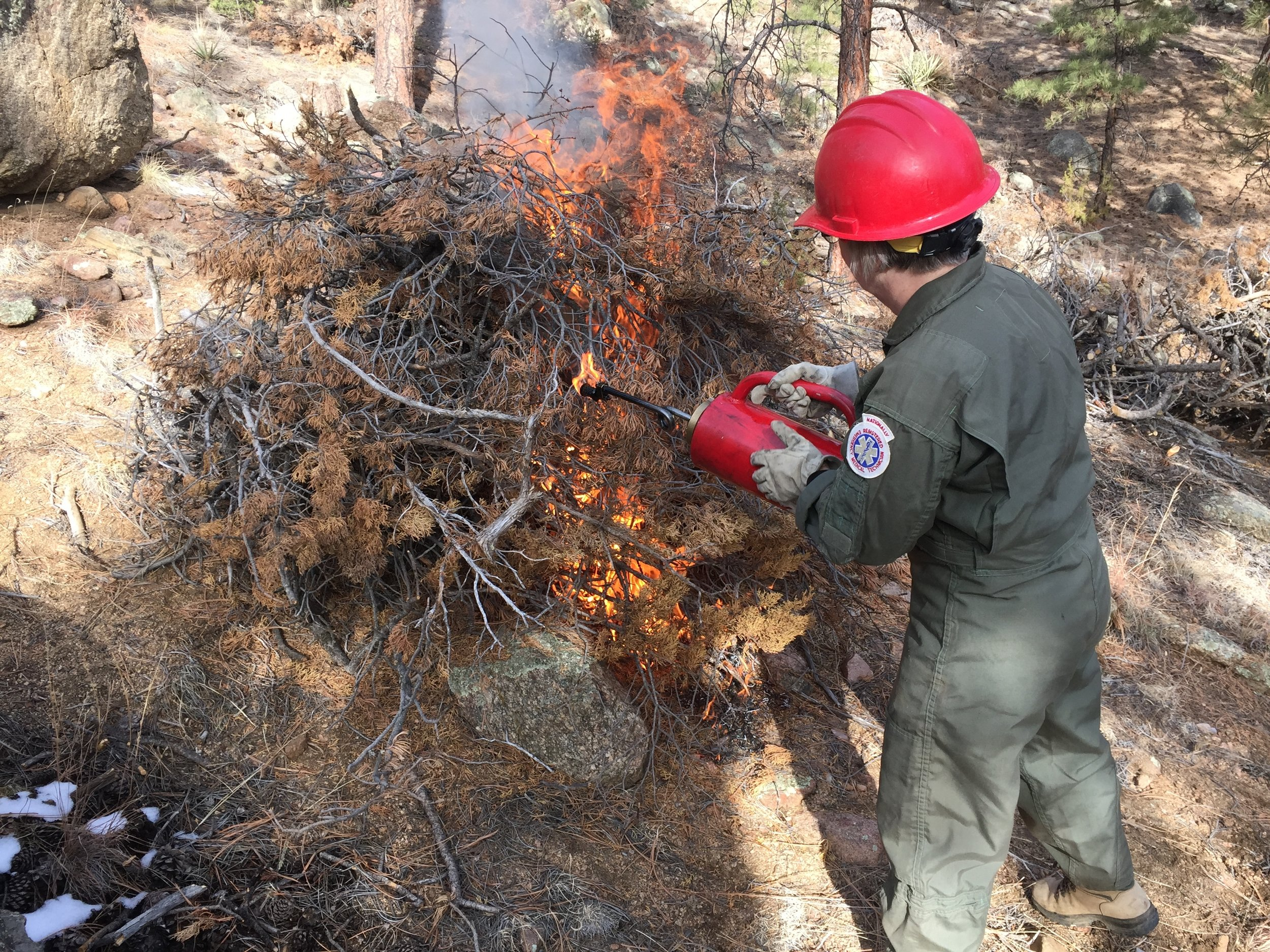 A landowner in Santa Fe County implements their own pile burn project.