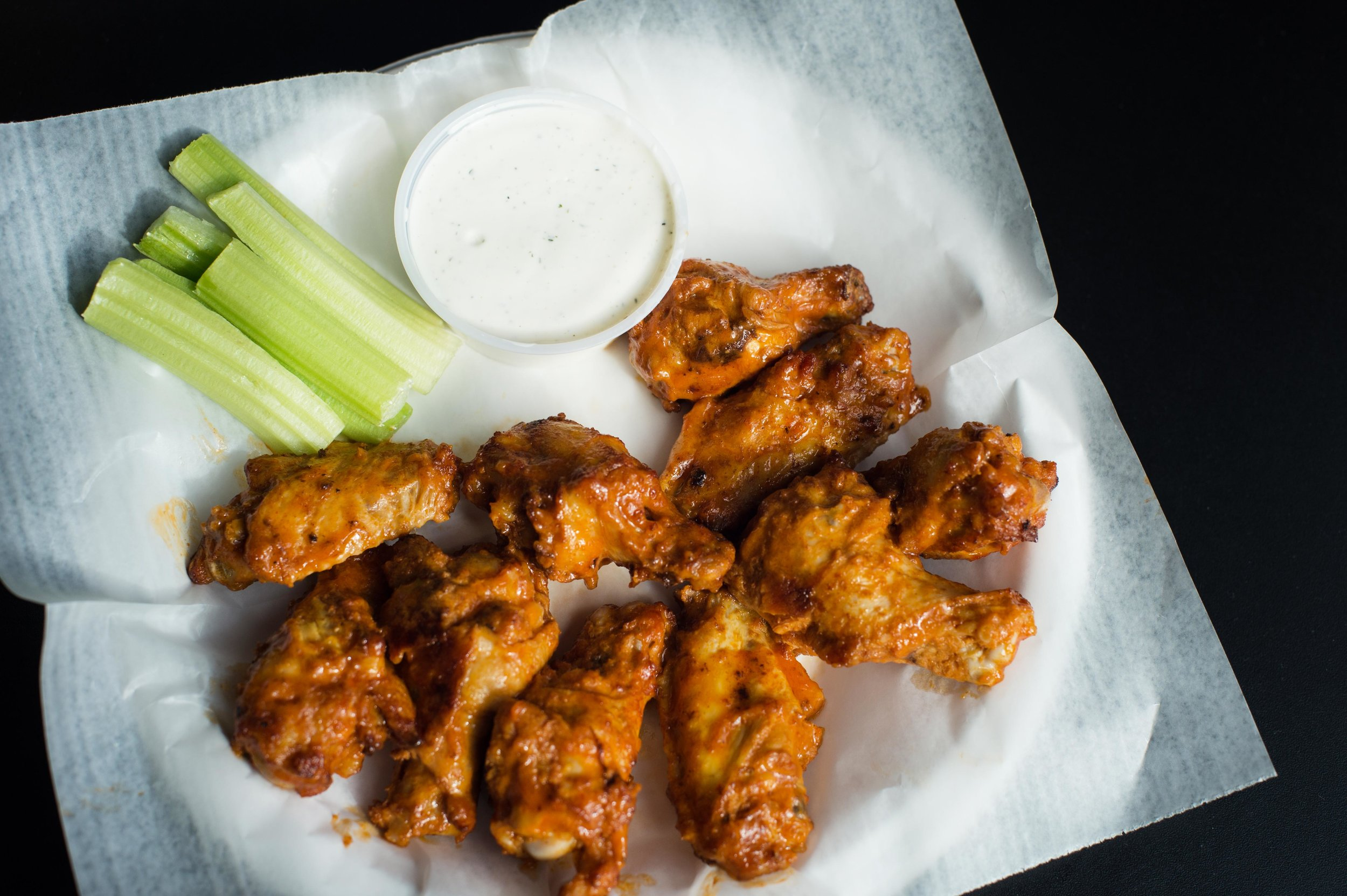 Buffalo Wings - 10 tasty wings served with celery sticks & your choice of dipping sauce!