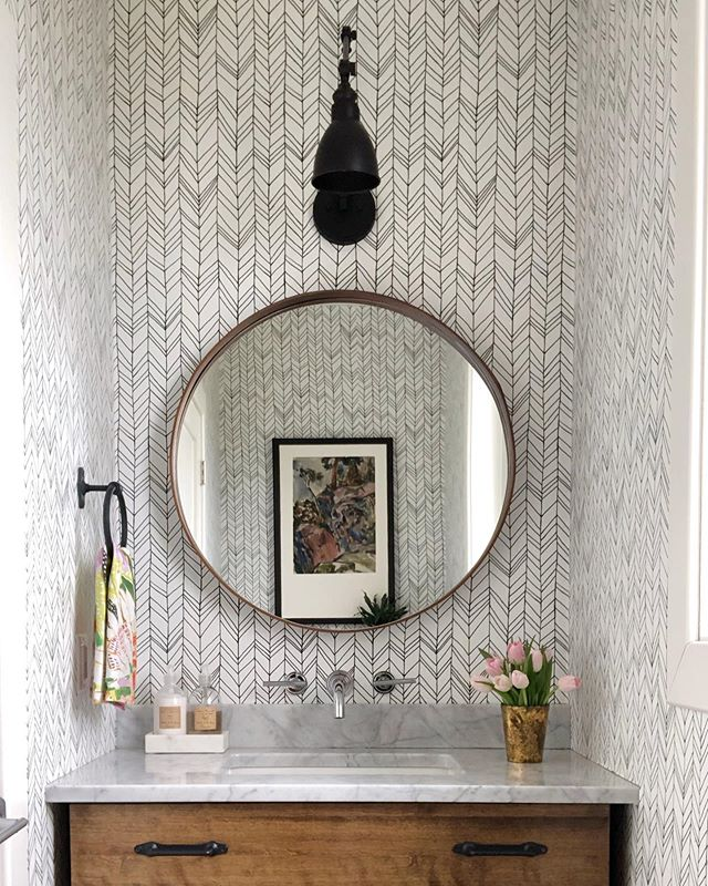 It's Friday! Friday! Posting this photo of my bathroom on Friday! (I hope you sang that in your brain to Rebecca Black's classic tune 'Friday' cause that was totes my intention) The framed watercolour by Don Wright in the reflection (framing by the best @newfoundlandcanvas ), the fun wallpaper, and those purdy tulips make me so happy 🤩🌷✨ . . . . . . . . #powderroom #patternplay #donwright #newfoudlandartist #bathroomdecor #interiordesign #residentialdesign #modandstanley