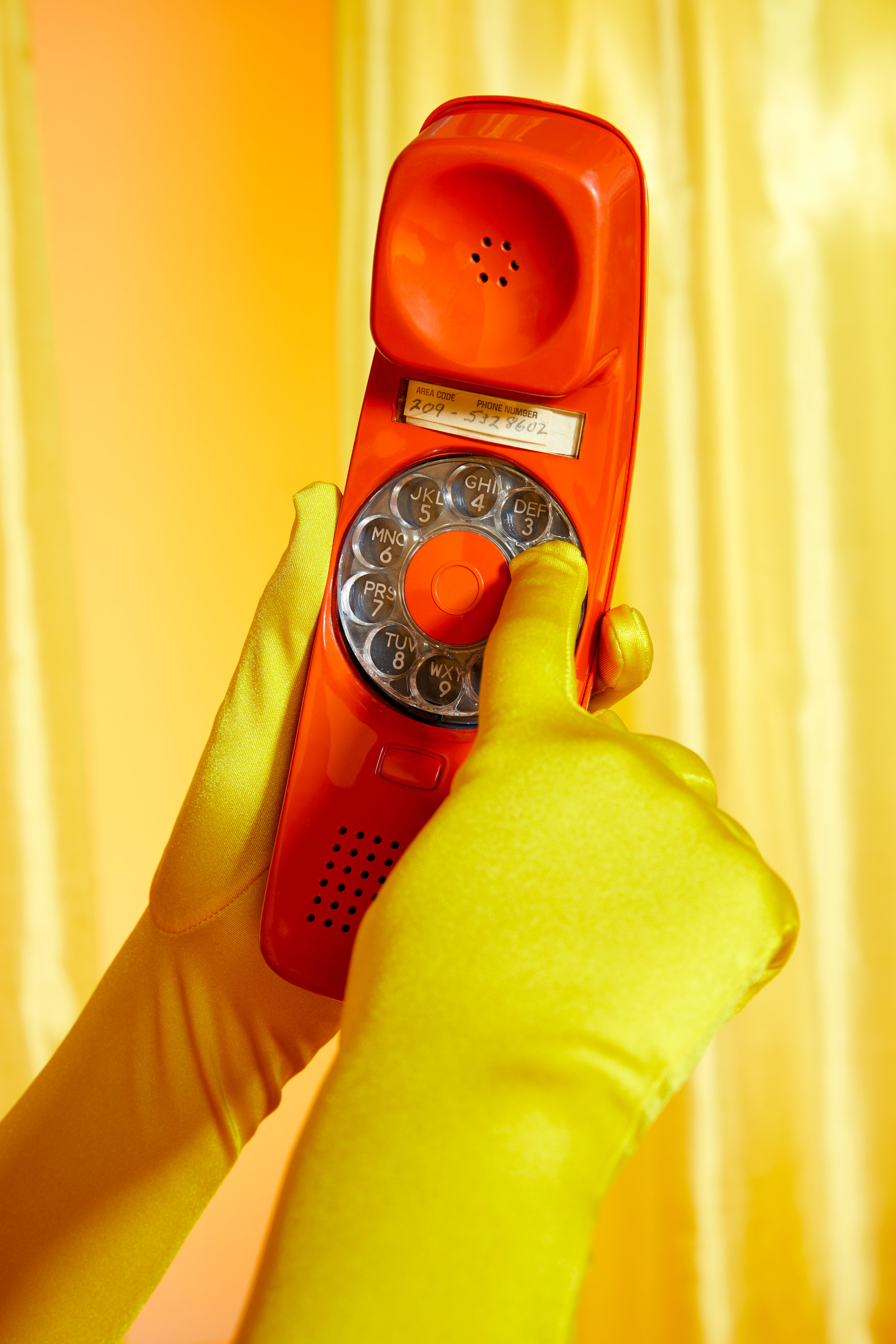 Orange-Yellow-Phone-Gloves-Dialing.jpg