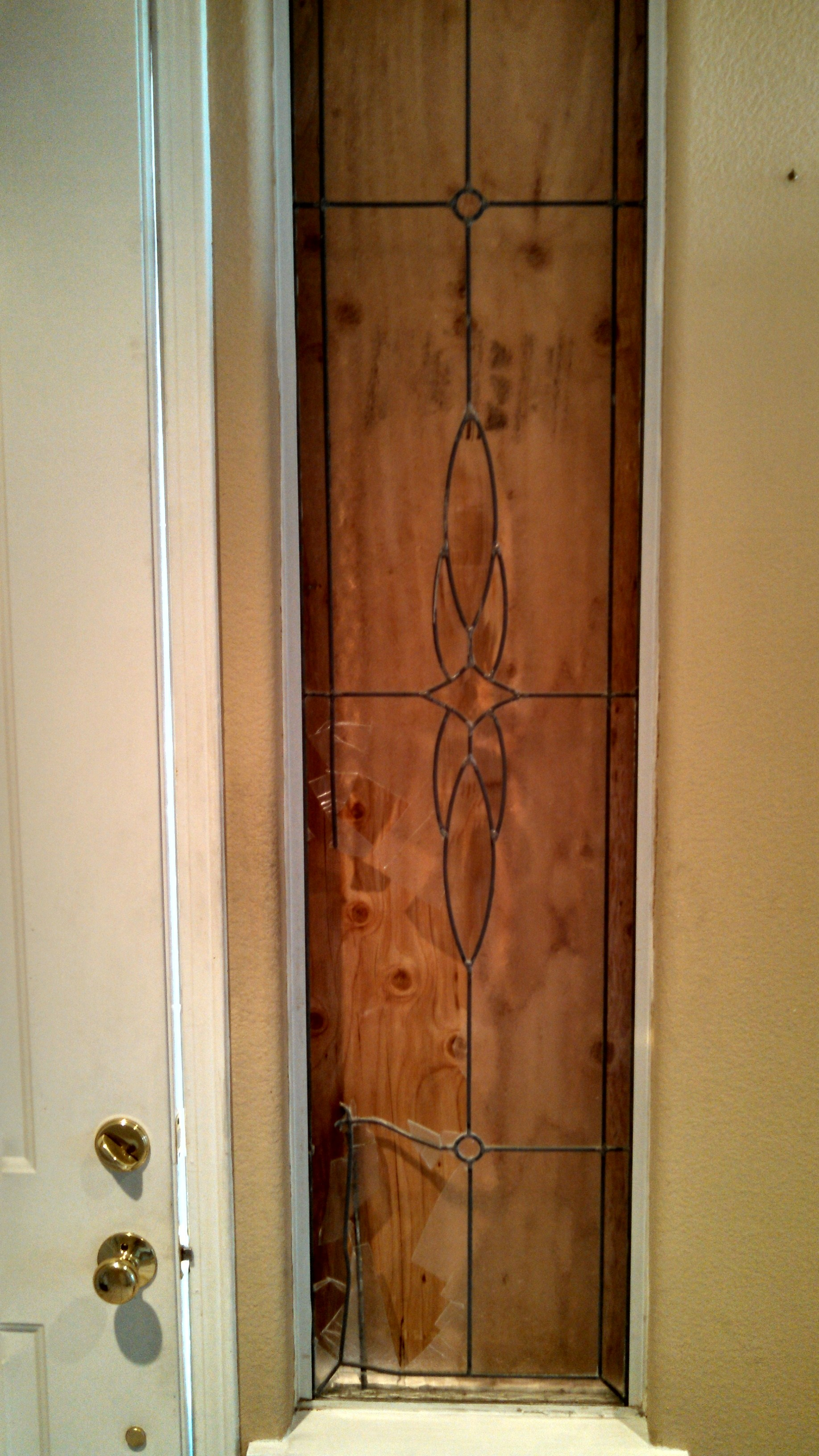 This sidelite was damaged by a soccer ball. The Shoppe pulled out the damaged piece, boarded up the opening, and repaired the panel where it was reinstalled into its home.