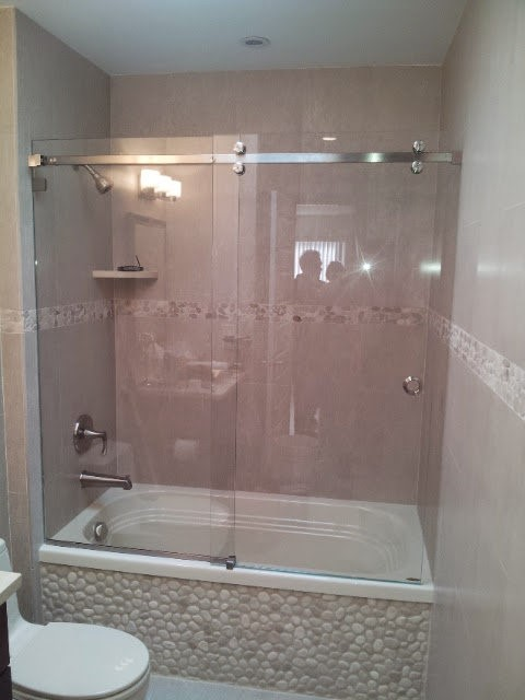 Easy glide barn door style shower unit with chrome hardware