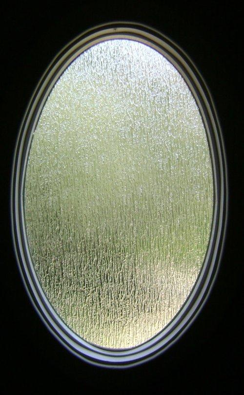 Oval Window in Rain Glass