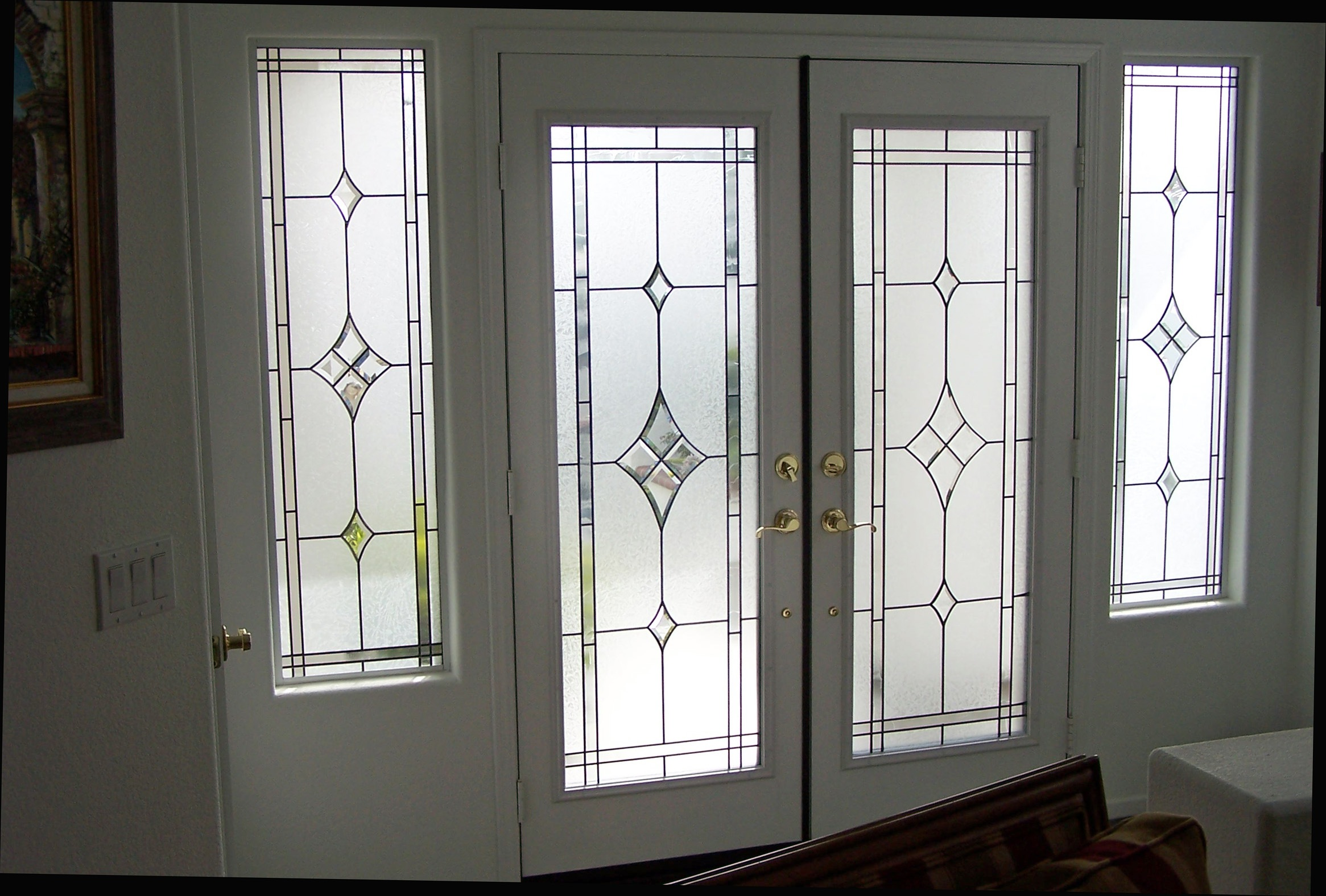 Custom glass inserts for these beautiful French doors and matching sidelites.