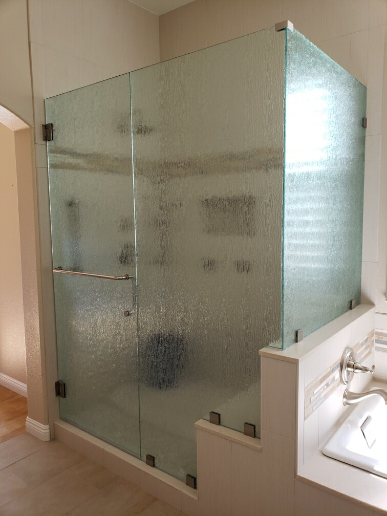 Door, panel, and return glass shower unit with custom cut outs