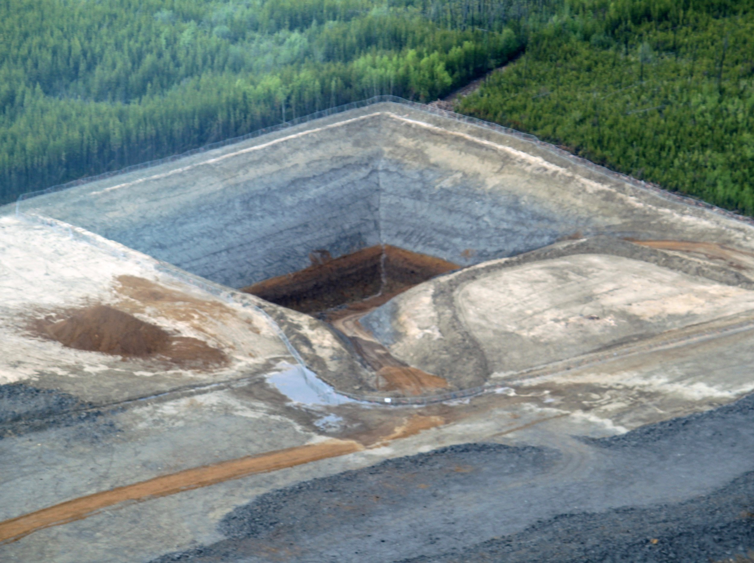 An aerial view of PRISM's bulk sample pit at Clear Hills