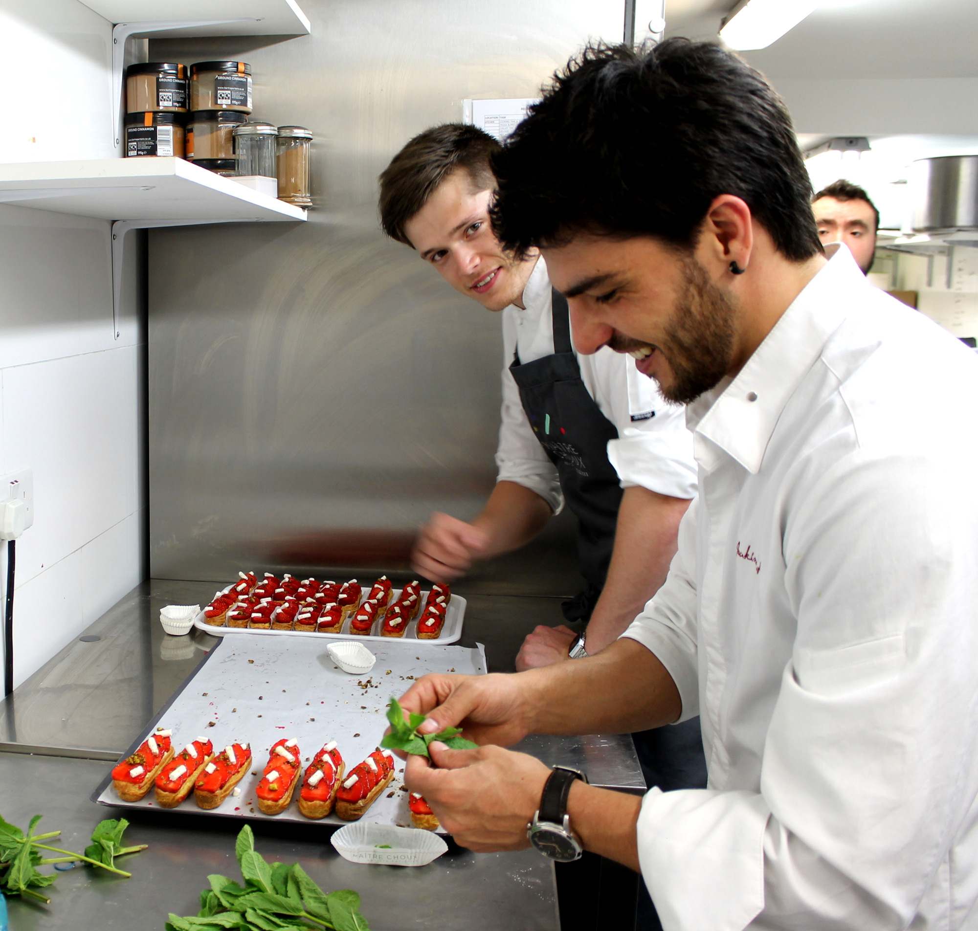 The Stagiaire and Joakim garnish strawberry éclairs