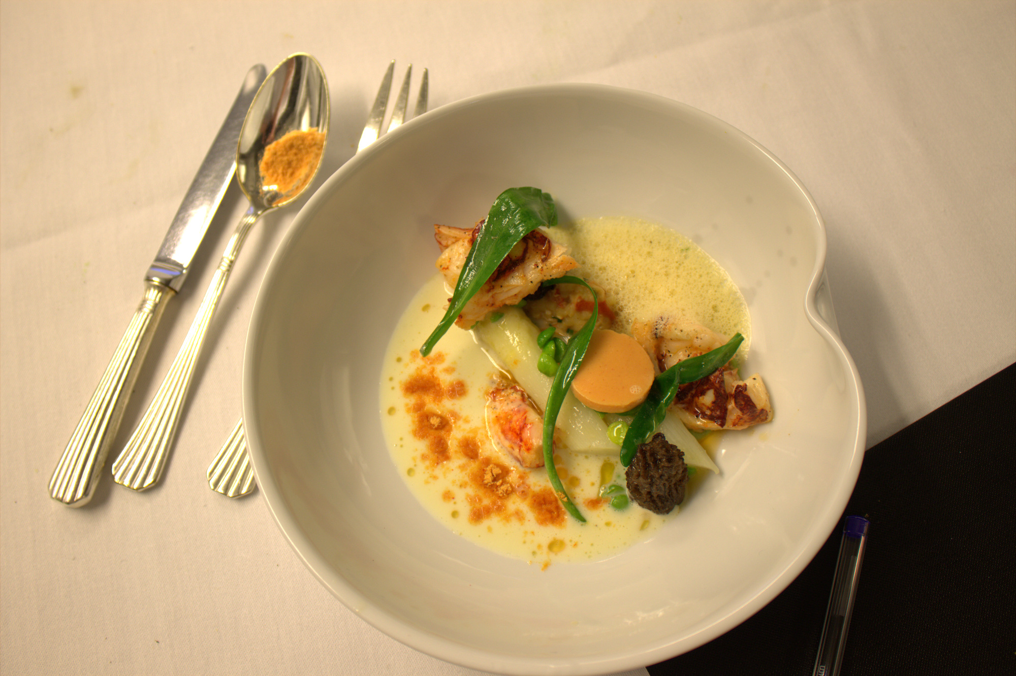 Poached lobster, Belgian asparagus, models and sea aster
