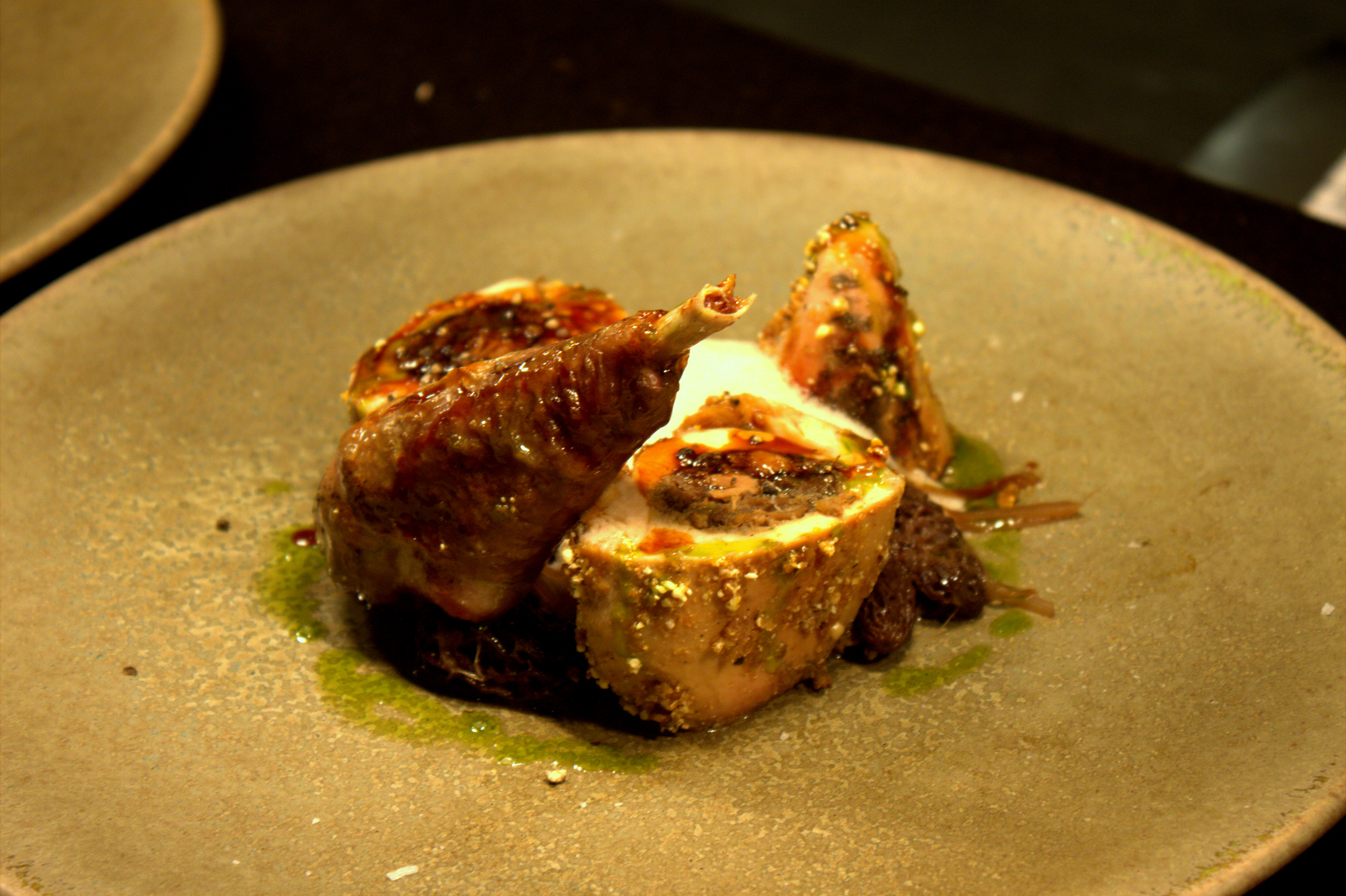 Bread dough-baked guinea fowl with morels