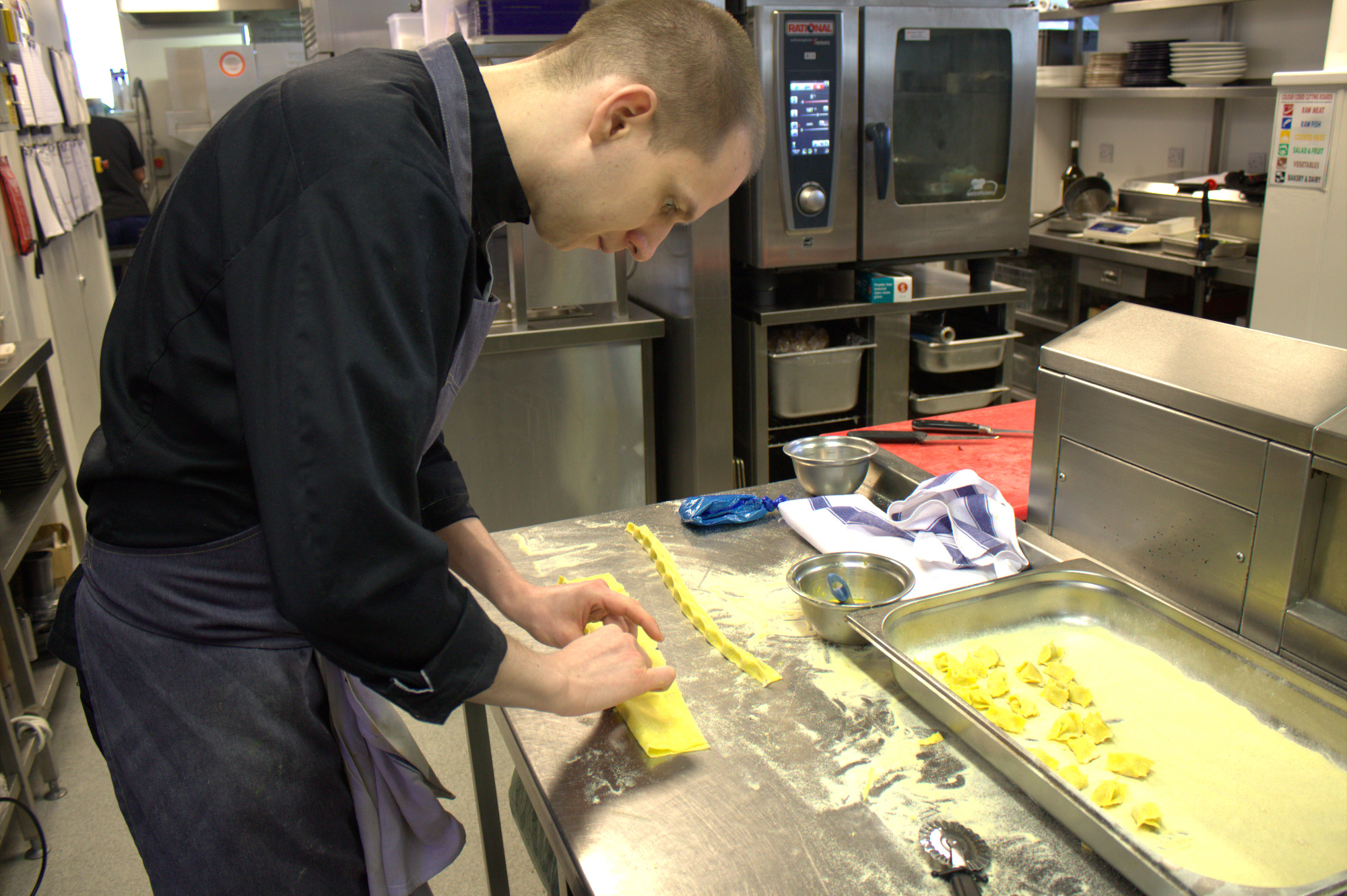 Lucas, one of the sous, preps the new agnolotti