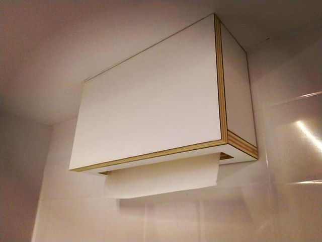 We added a custom made hand towel dispenser. Can be used with one hand and is up out of the way. Designed around cheaper commercial towels that you can but in bulk. Same lightweight poplar ply as rest of kitchen. . #kitchen #clean #paper #towel #ply #plywood #tinyhousekitchen #tinyhousenz #nzmade #simple #buildnz #build #minimalism @plytechinternational #plywoodfurniture
