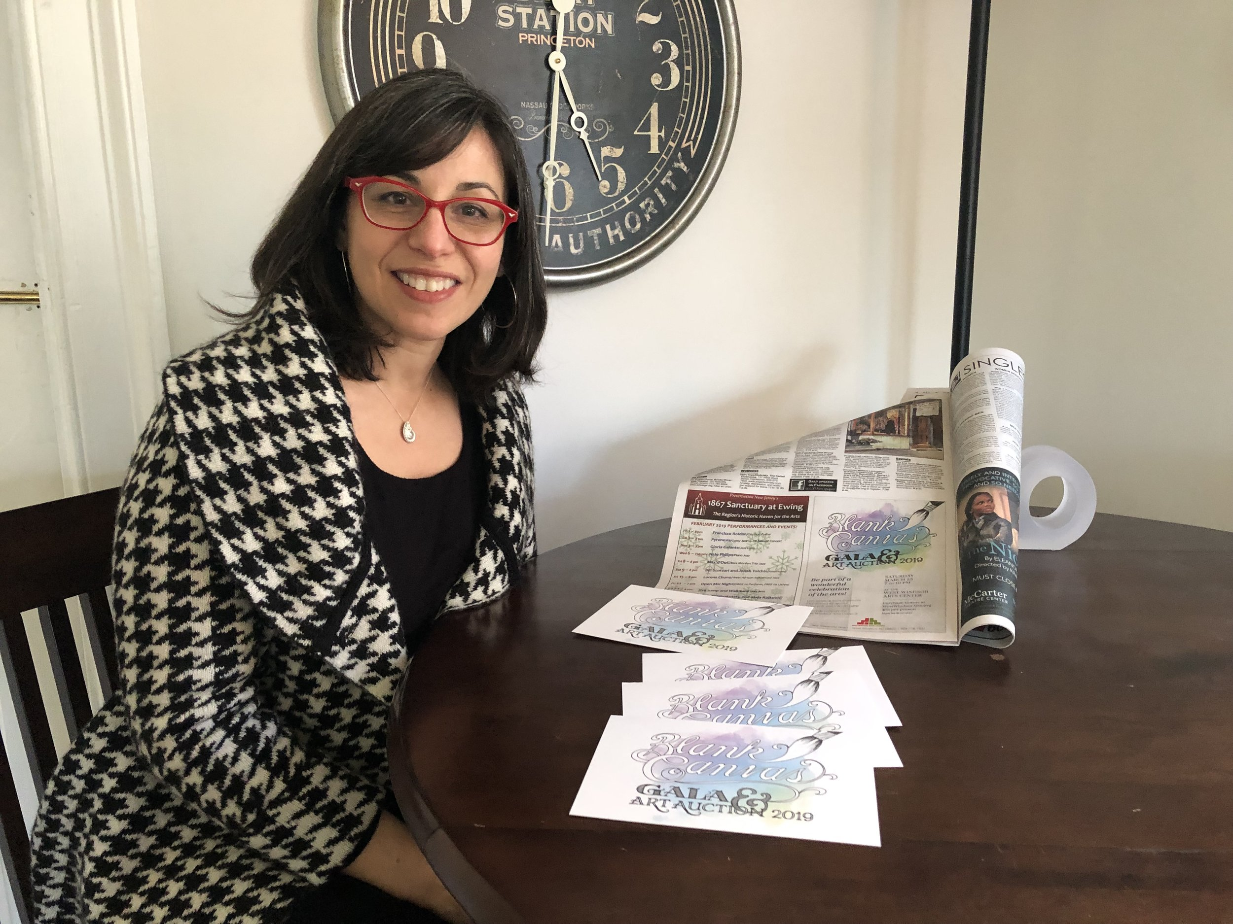 West Windsor Arts Council's Aylin Green stops by the Ananta office to check out the new invitations and ads for her organization's major fundraiser of the year.