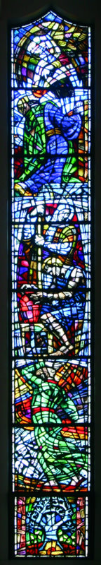 The second window on the right presents three earlier visionaries - Isaiah at the top, Jeremiah, and at the bottom Ezekiel in the valley of dried bones.