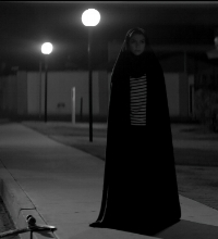 Cropped still from  A Girl Walks Home Alone at Night . Sheila Vand as The Girl. Courtesy of Kino Lorber's press kit for the film.