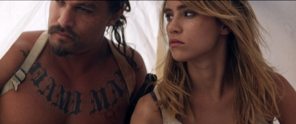 Still from  The Bad Batch . Jason Momoa as Miami Man and Suki Waterhouse as Arlen. Courtesy of NEON's press kit for the film.