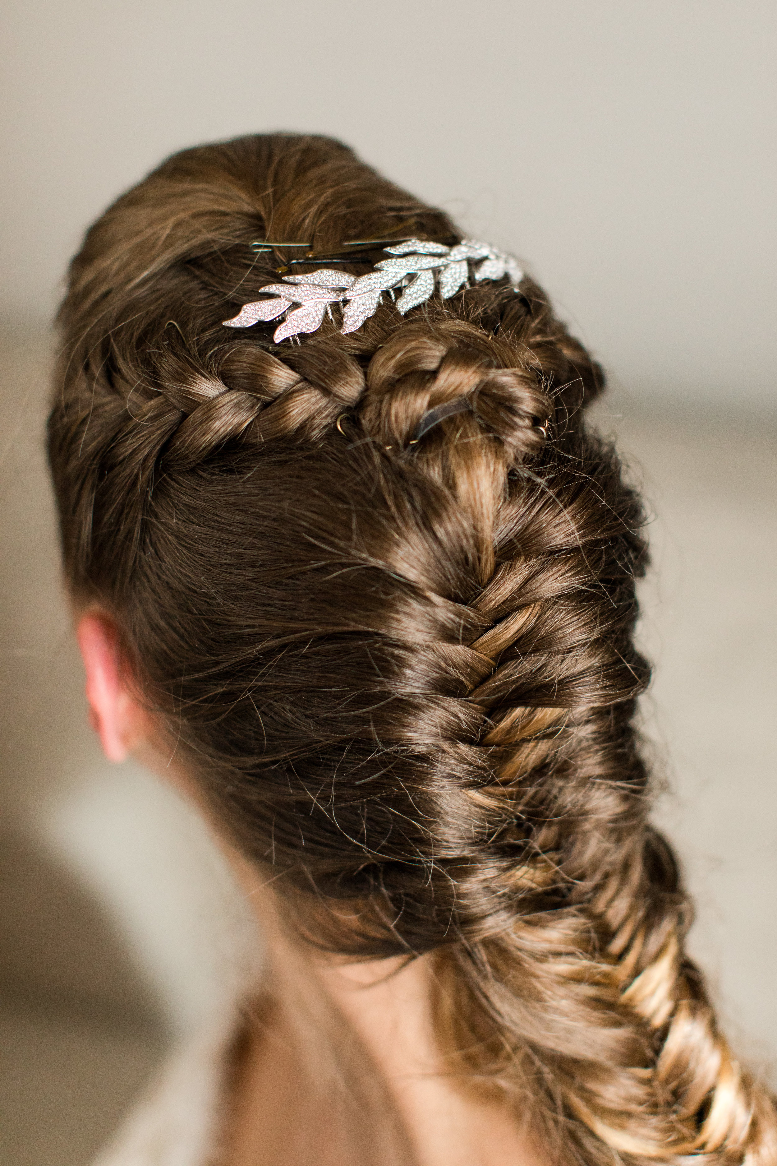 braided bridal hair with laurel comb detail