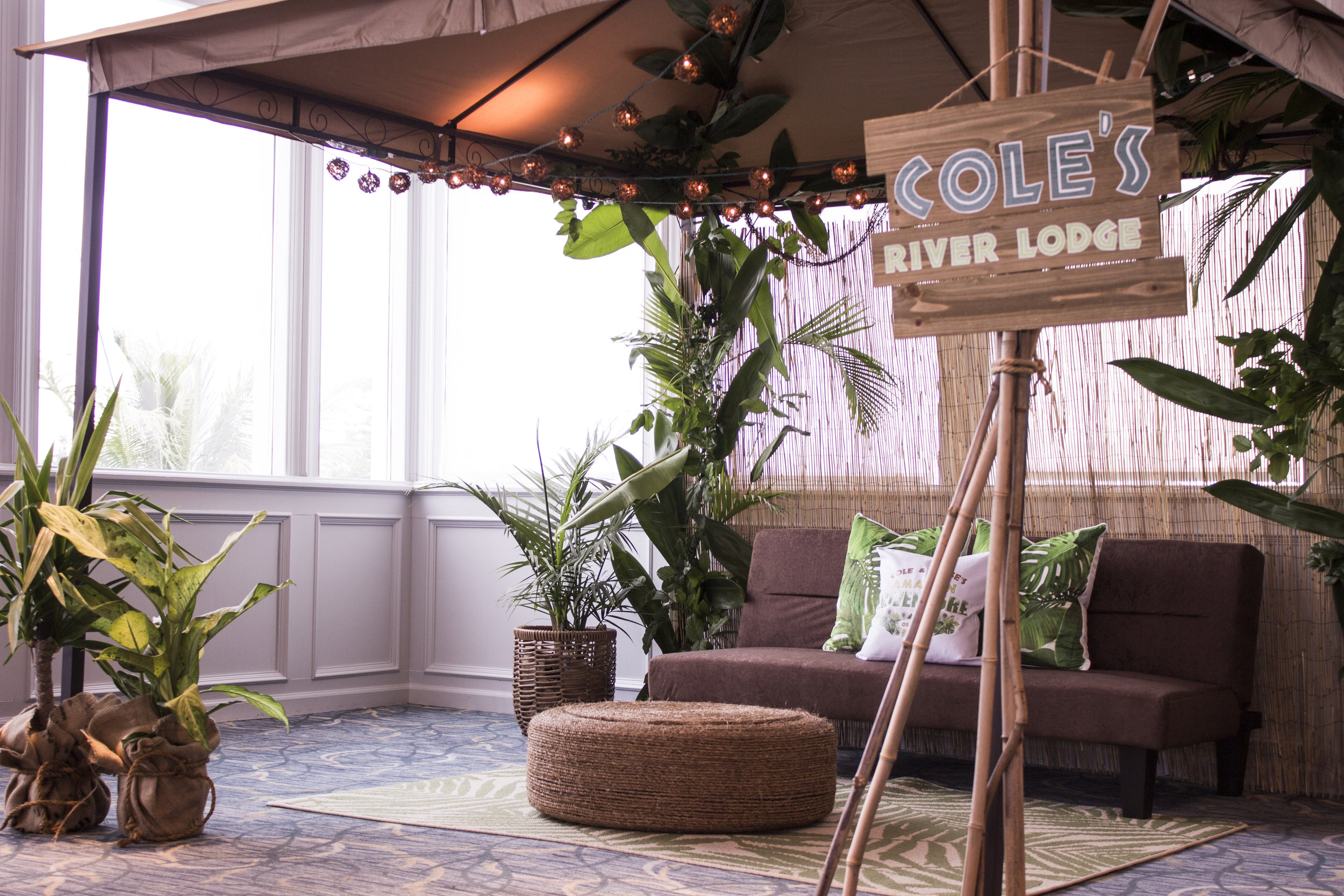 Amazon Jungle B'Nai Mitzvah Cabana Lounge with Rope Ottoman and Live Greens and custom wood sign from Bombshell Graphics at Channel Club by Magnolia West