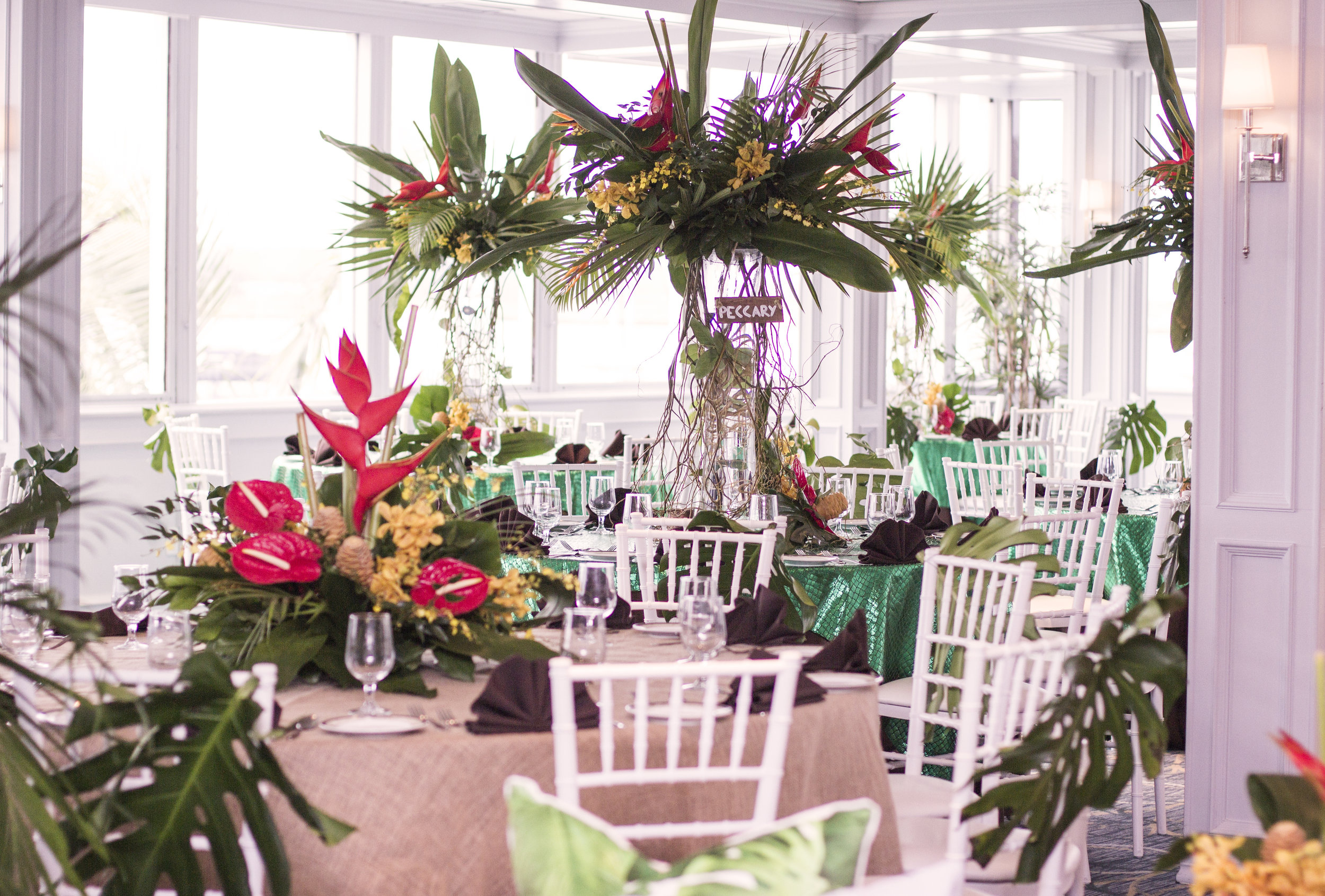 large tropical floral centerpiece for amazon jungle themed mitzvah