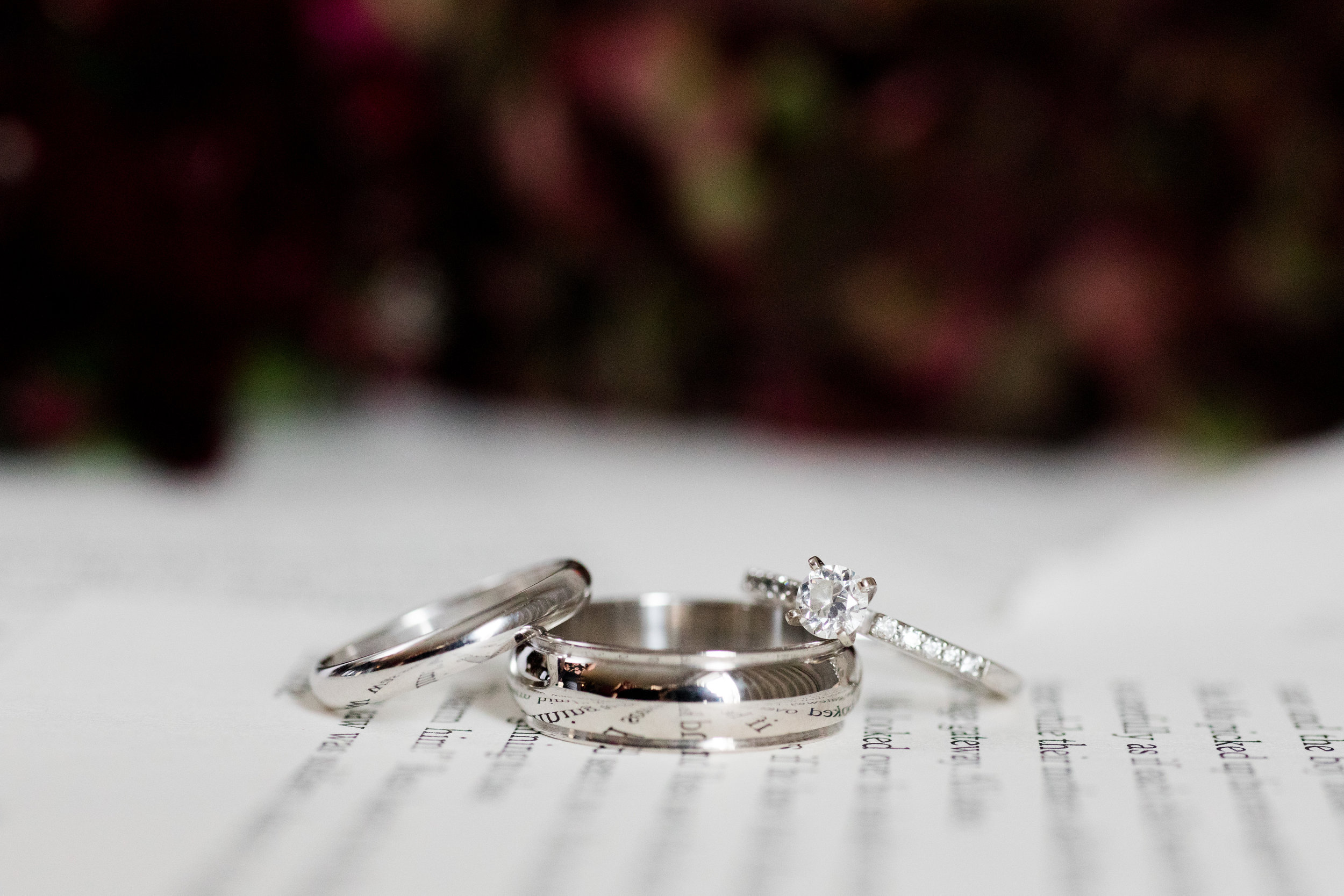 Wedding rings and engagement rings with white gold and diamonds on book page